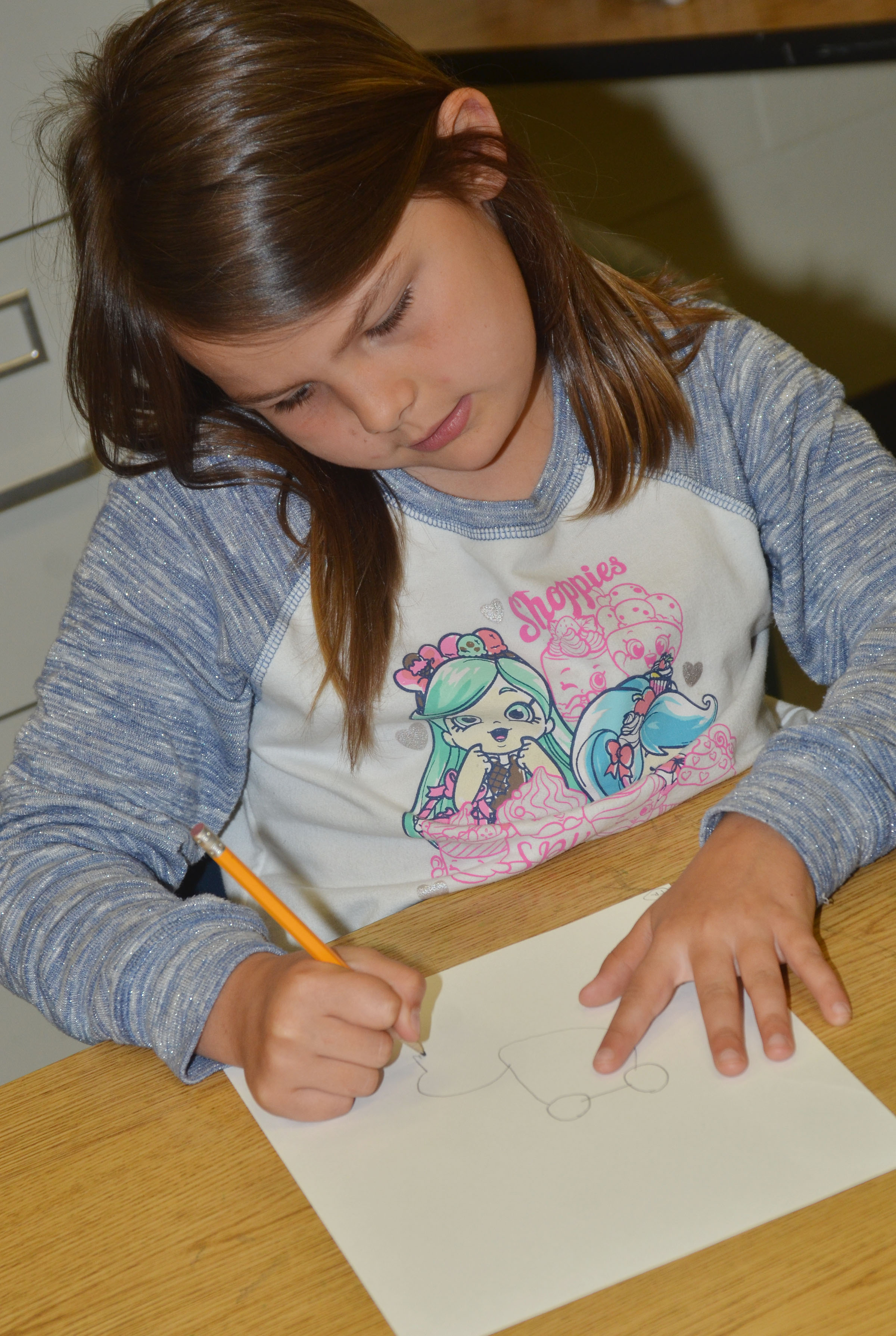 CES second-grader Dorothy Shively draws her frog scene for the Save the Frogs contest.