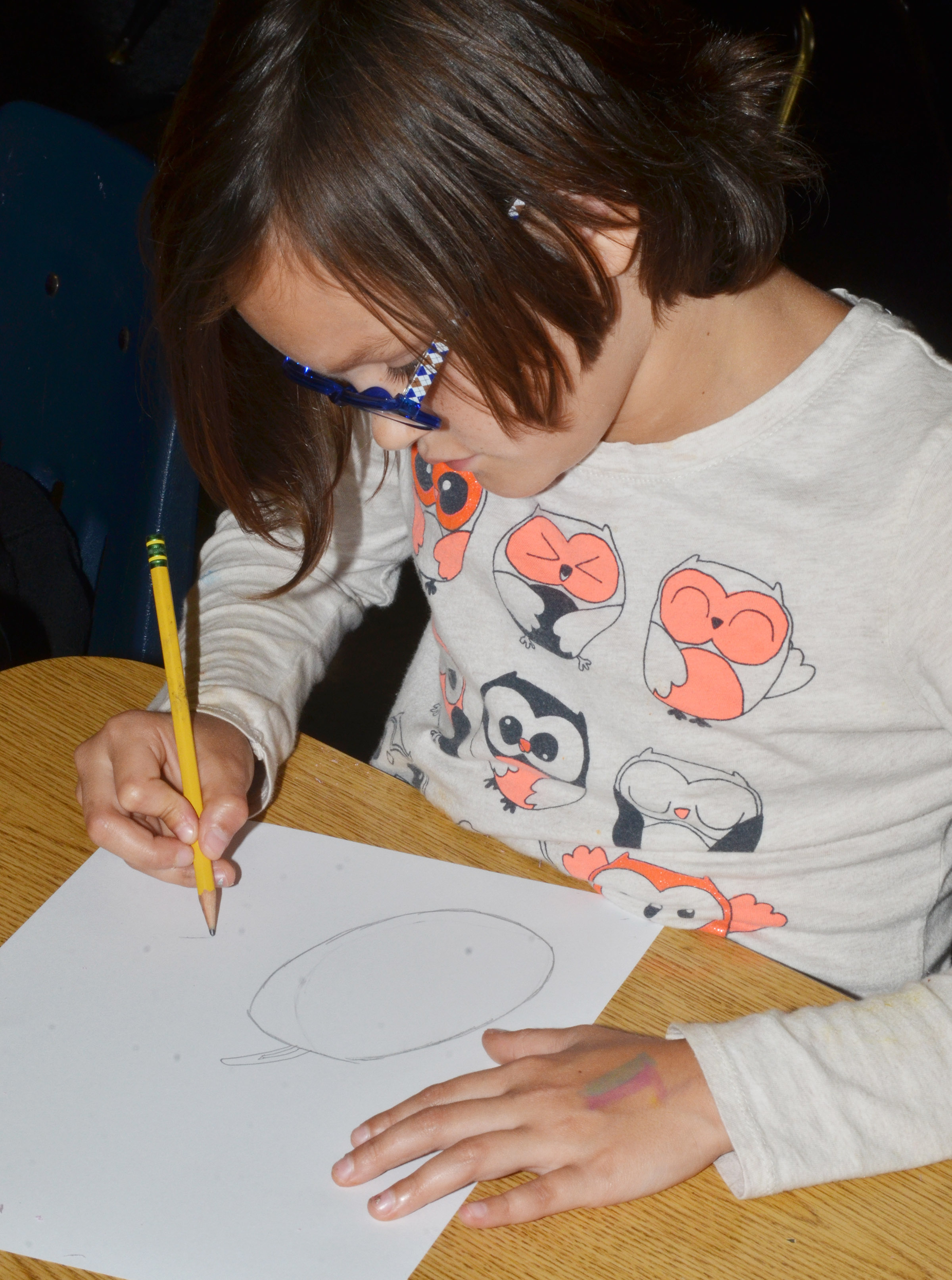 CES third-grader KayLee Lamer draws a still life.