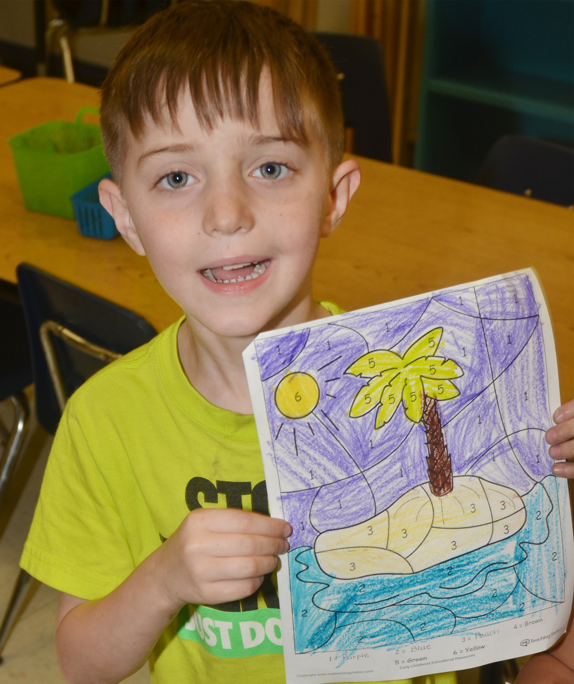 CES kindergartener Caleb Goodson holds his beach drawing.