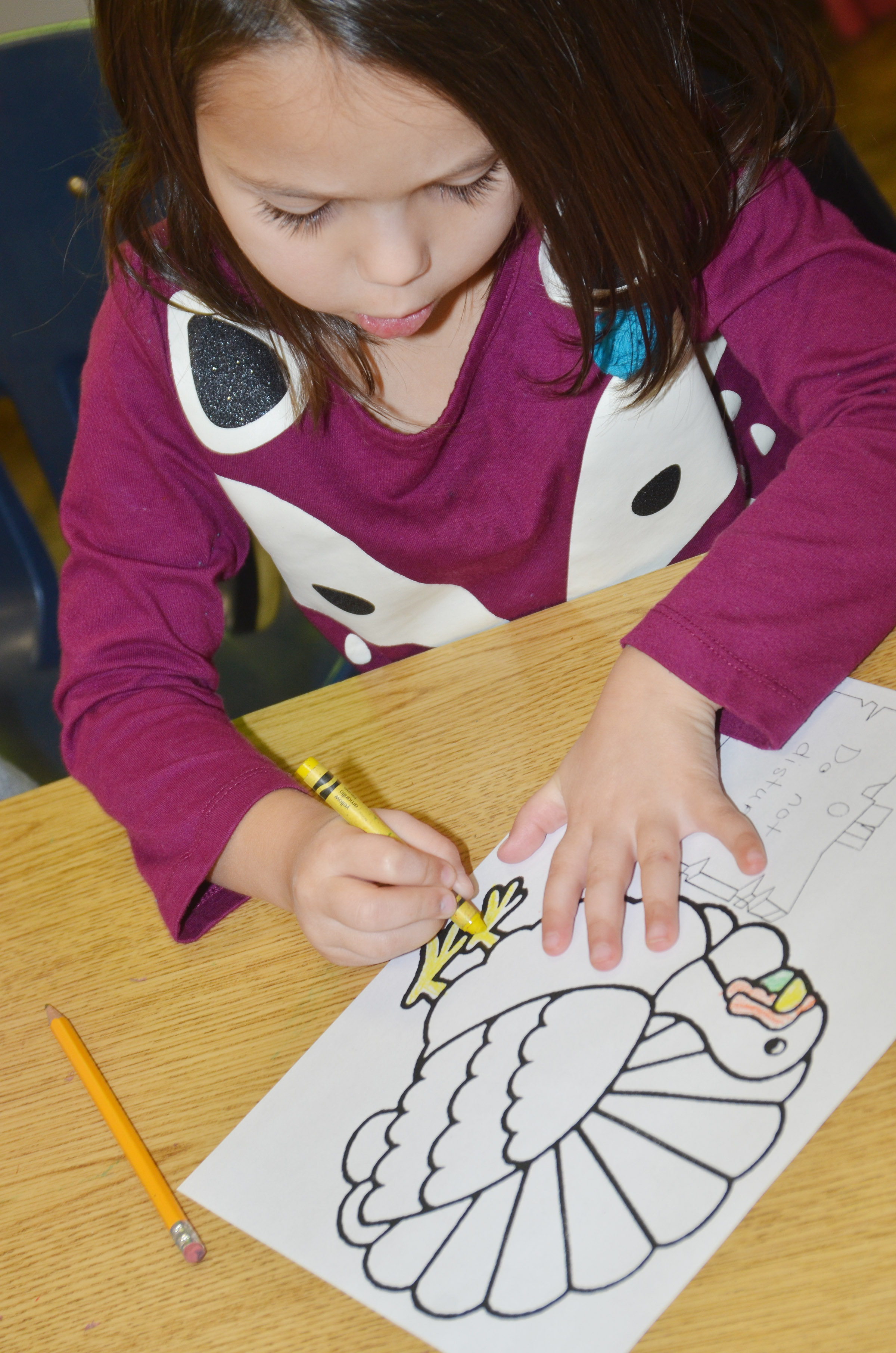 "CES kindergartener Tylee Britton colors her turkey. Her sign reads ""Do Not Disturb."""