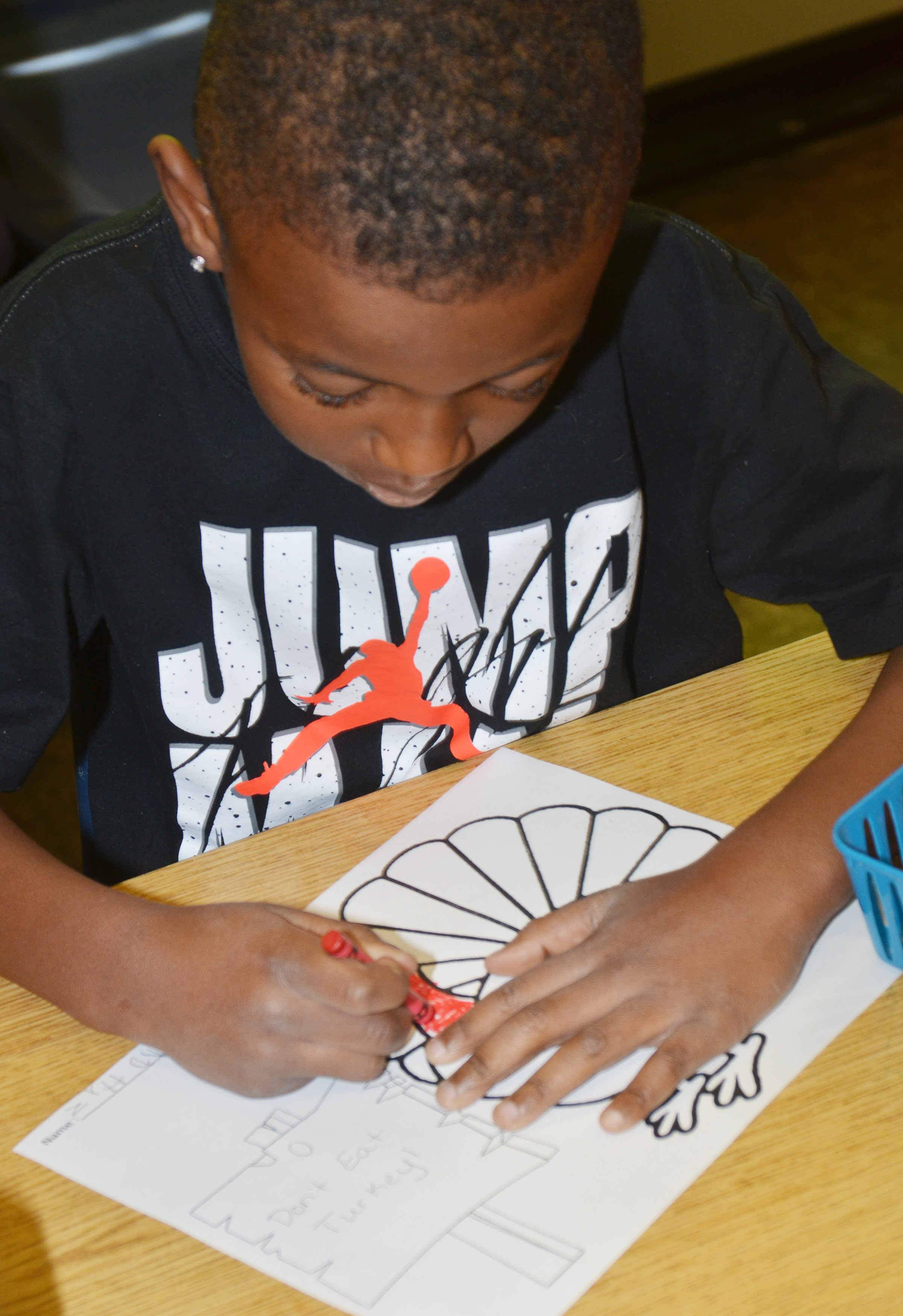"CES kindergartener Zyhaven Taylor colors his turkey. His sign reads ""Don't Eat Turkey!"""