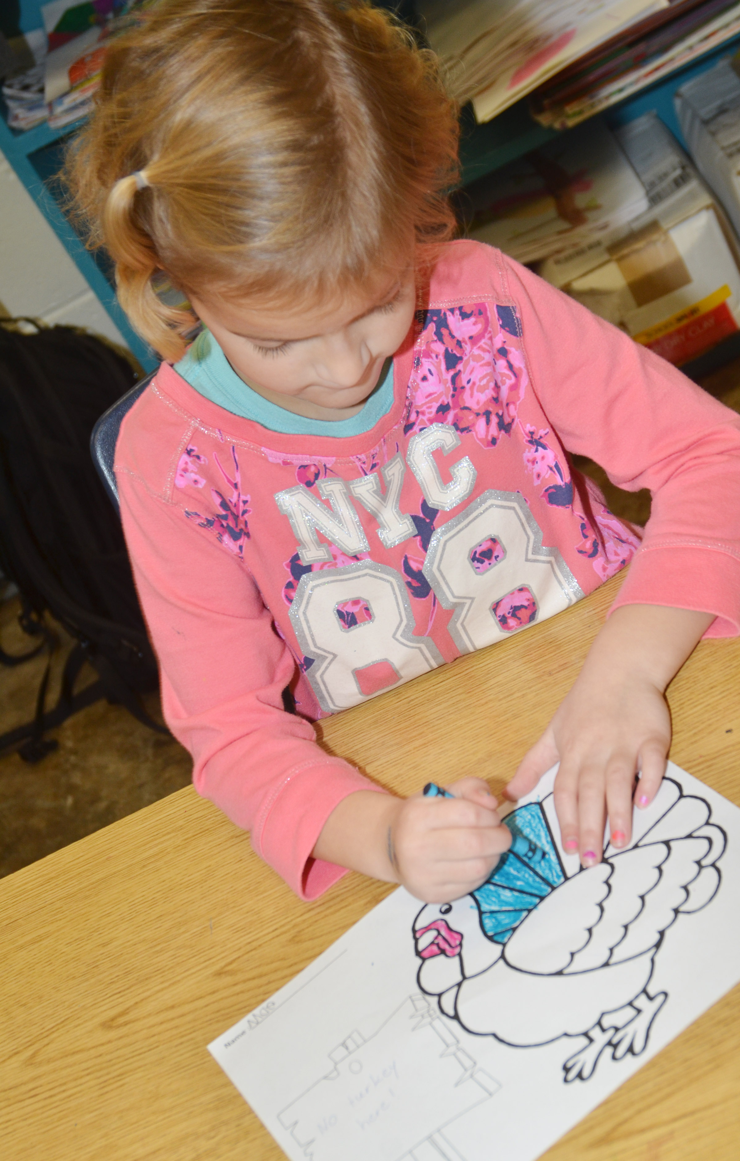 "CES kindergartener Mae Miller colors her turkey. Her sign reads ""No Turkey Here!"""