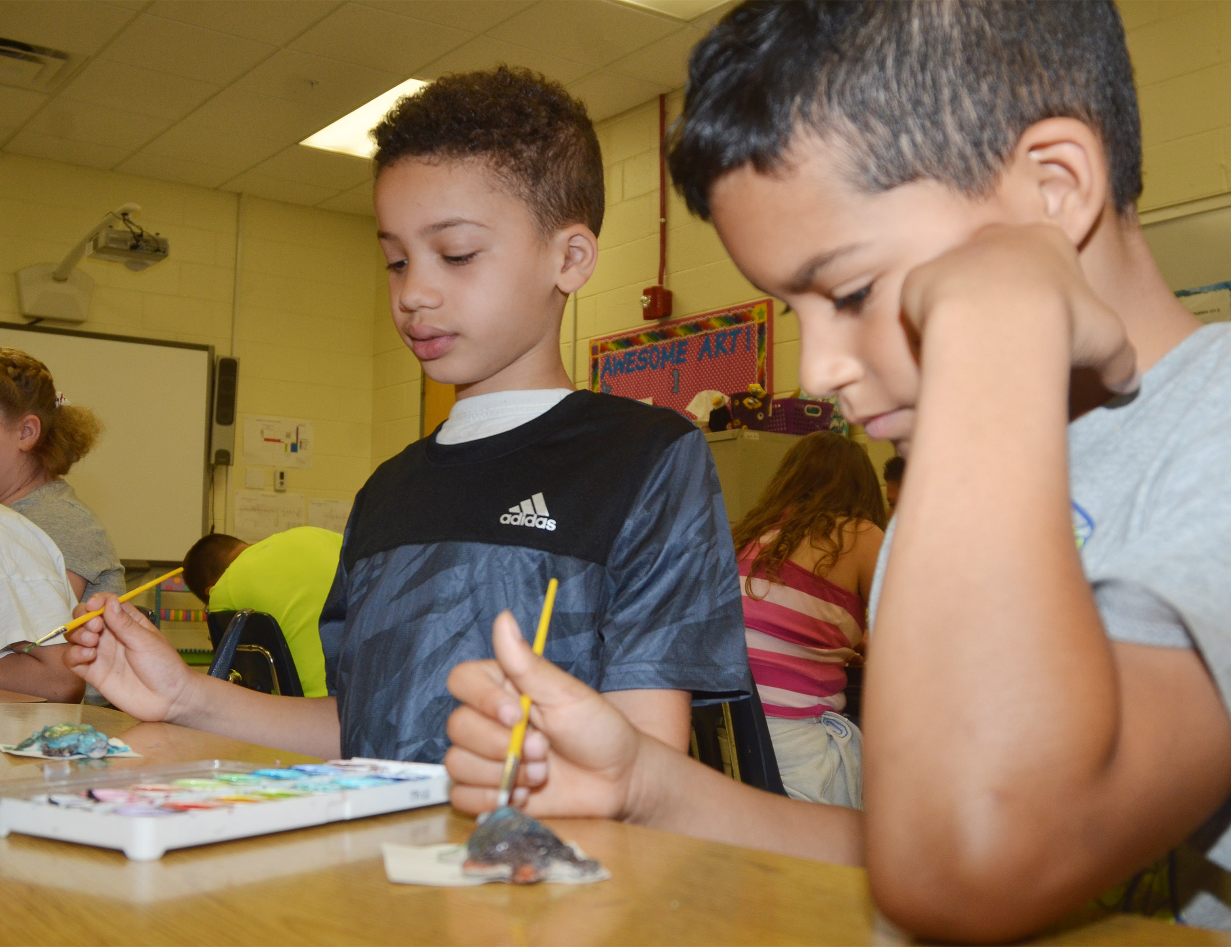 CES first-graders Bryant Mayo, at left, and Rizzo McKenzie paint their turtles.