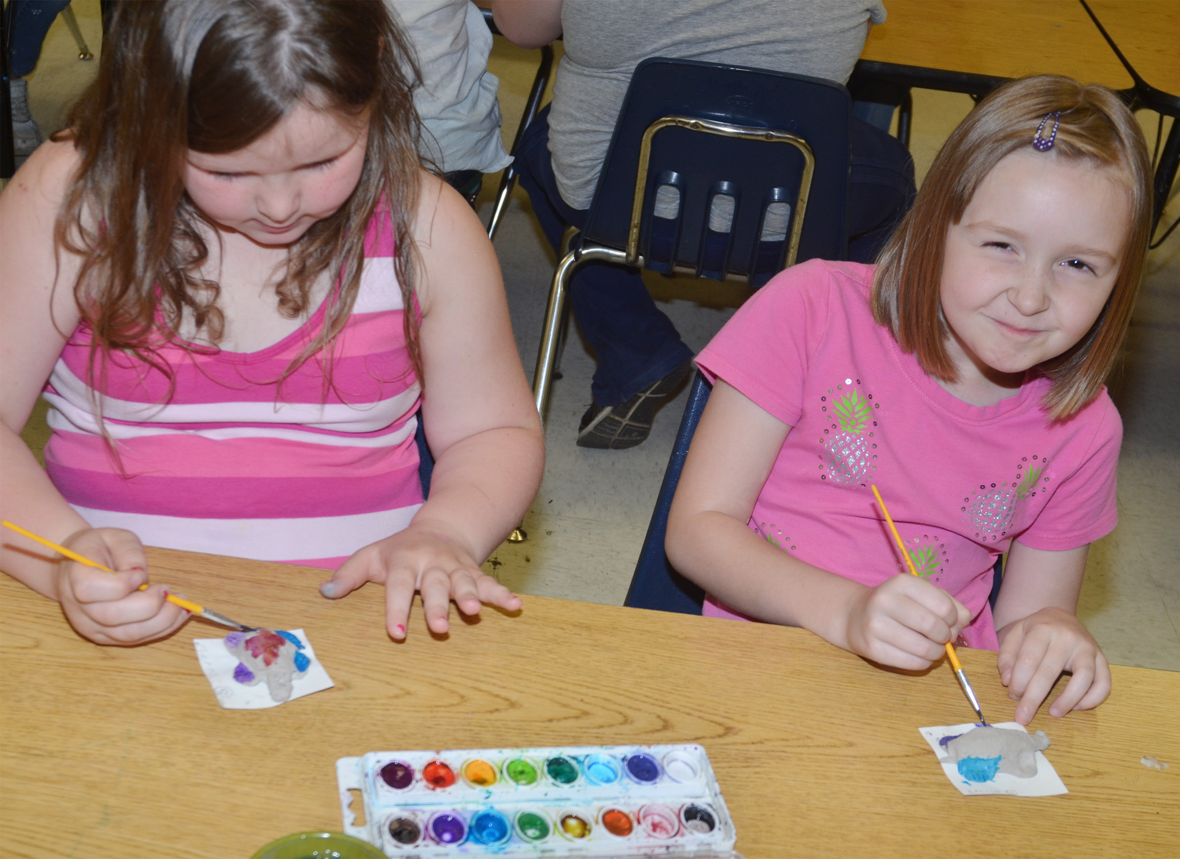CES first-graders Kierra Maupin, at left, and Gracie Murphy paint their turtles.