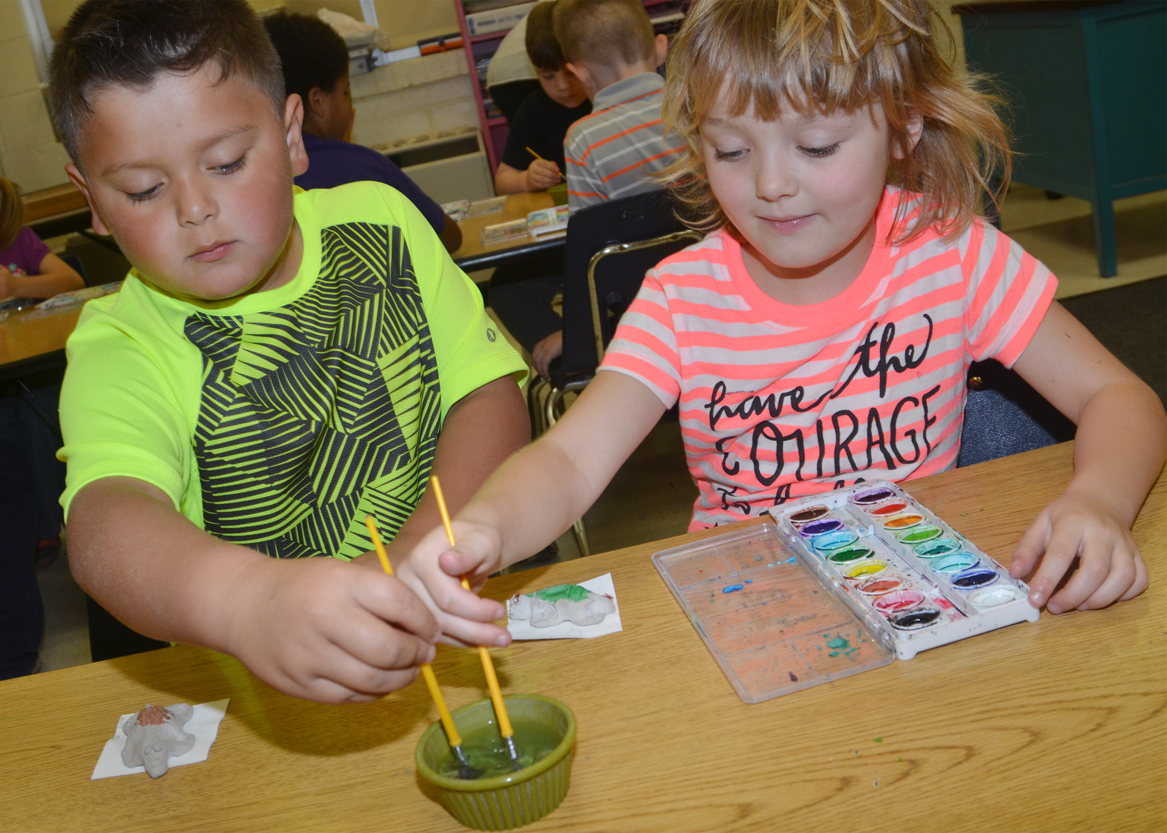 CES first-graders Alex Mixtega, at left, and Mylee Bell paint their turtles.
