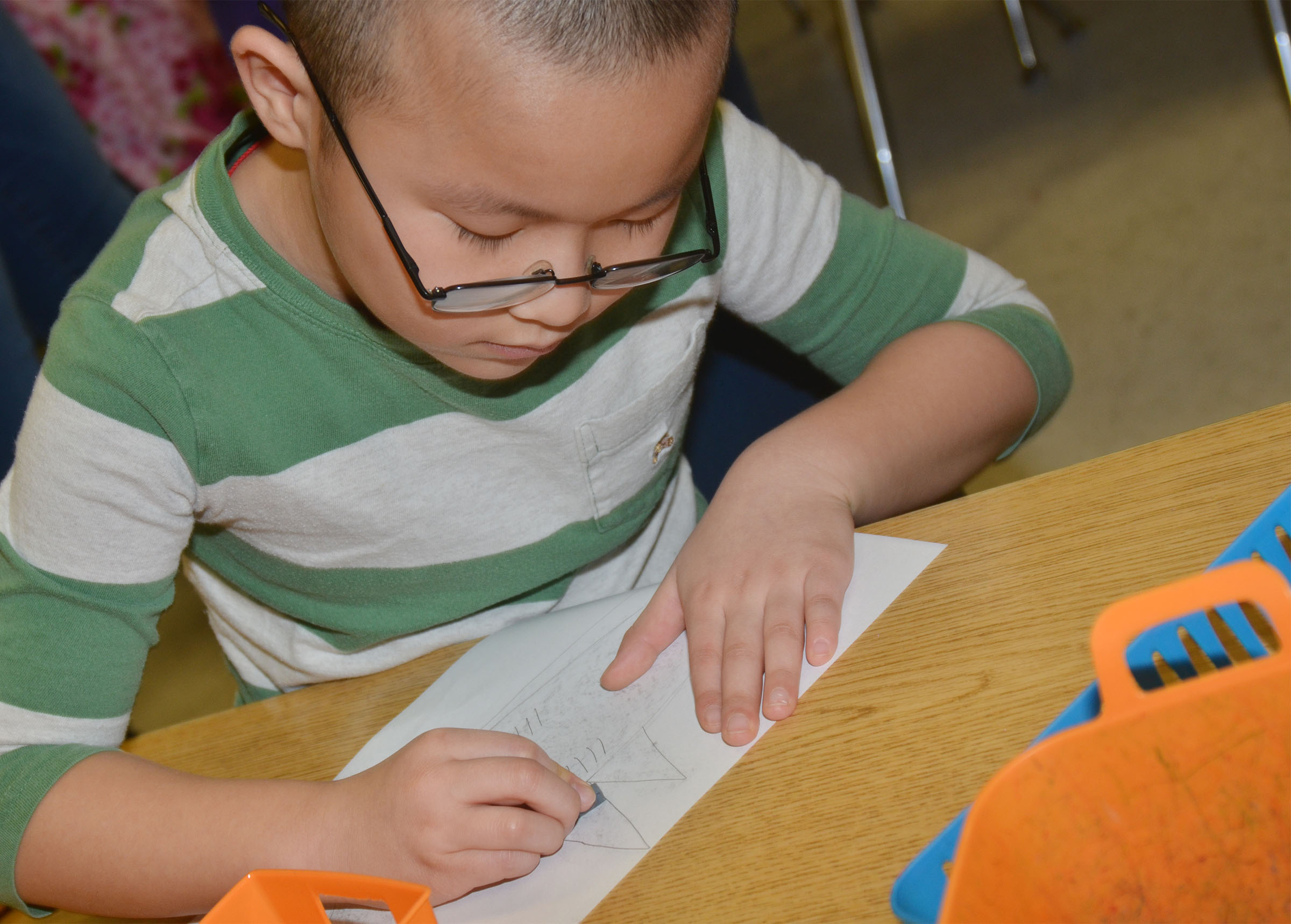CES second-grader Alex Yang colors his animal drawing.