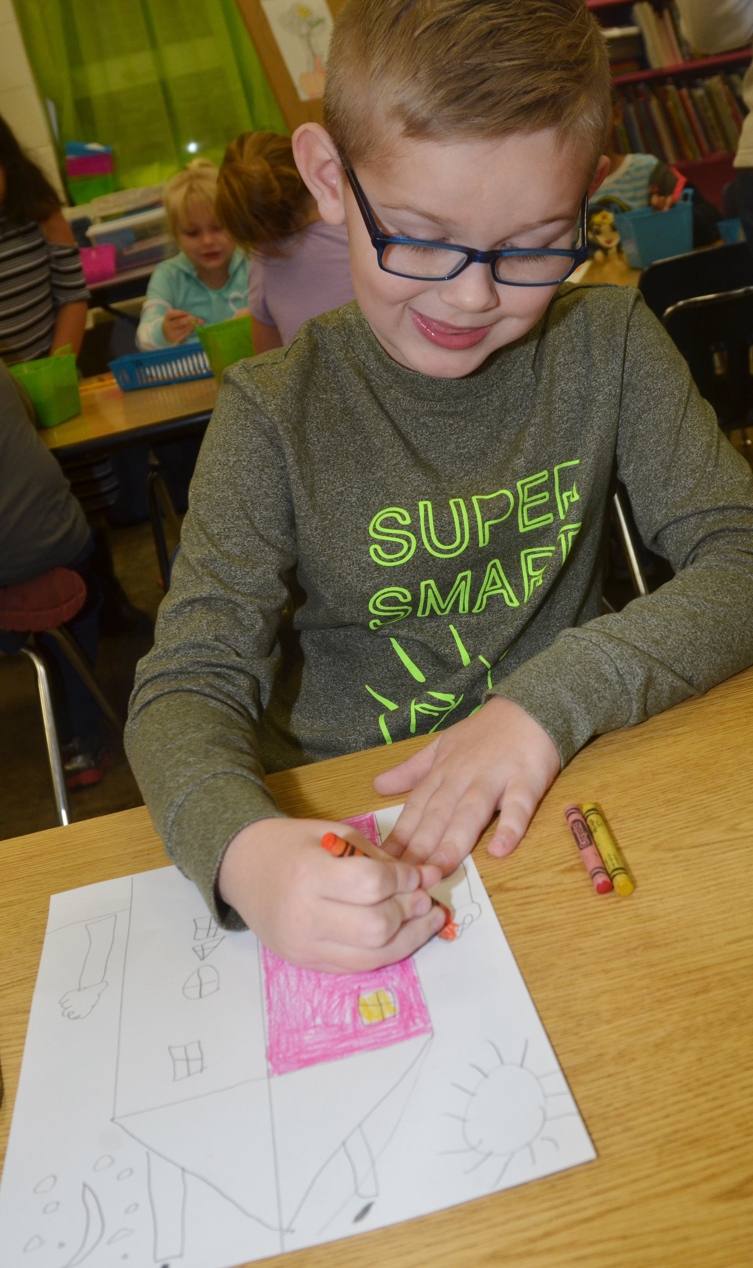 CES first-grader John Hagan Newton colors his warm and cool color house.