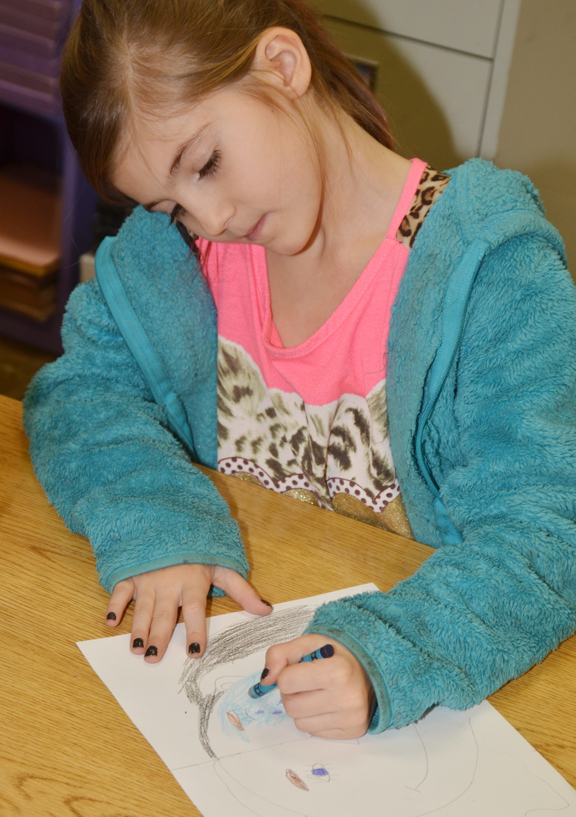 CES second-grader Madison Choate colors her warm and cool color face.