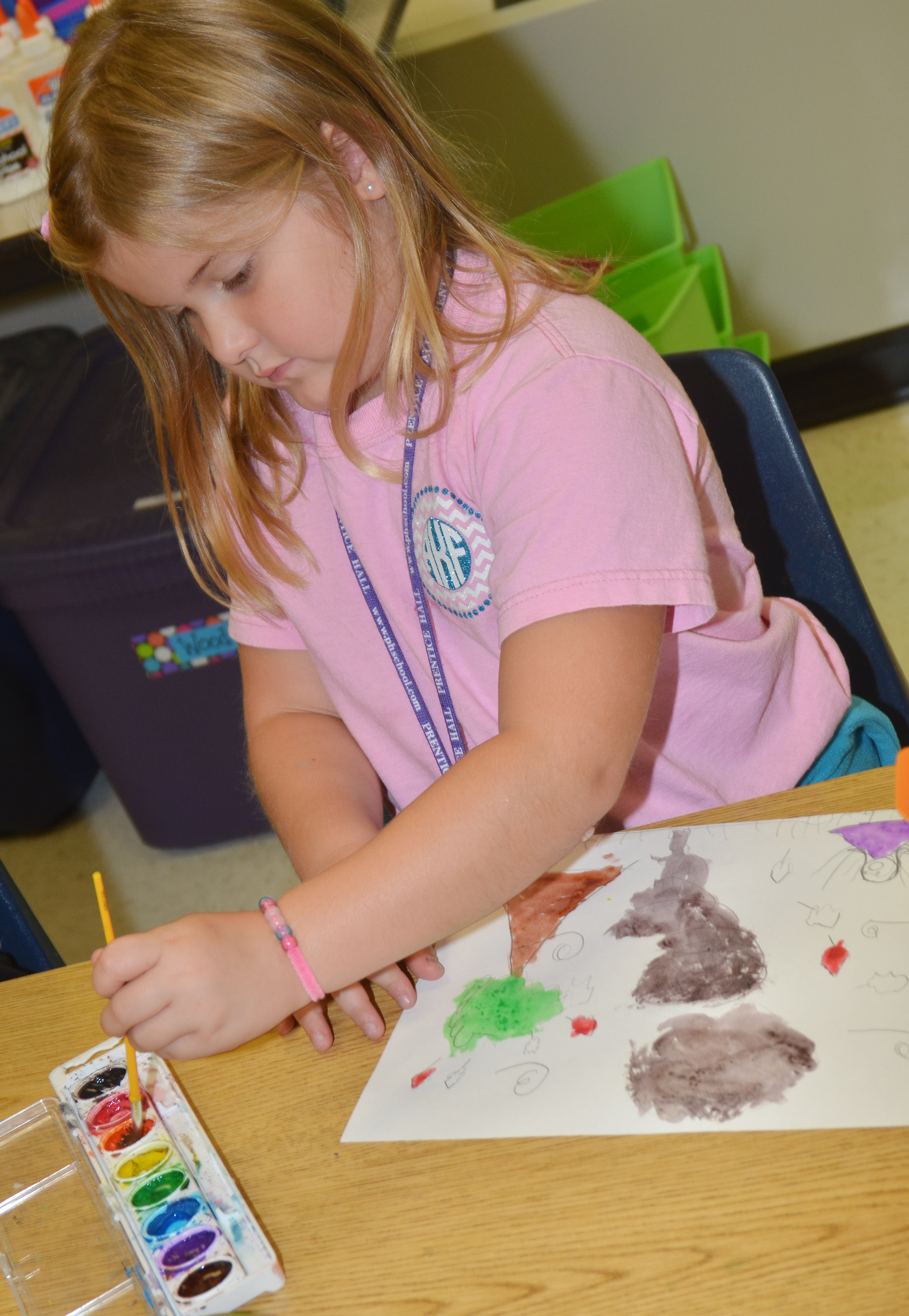 CES first-grader Aubreigh Knifley paints.