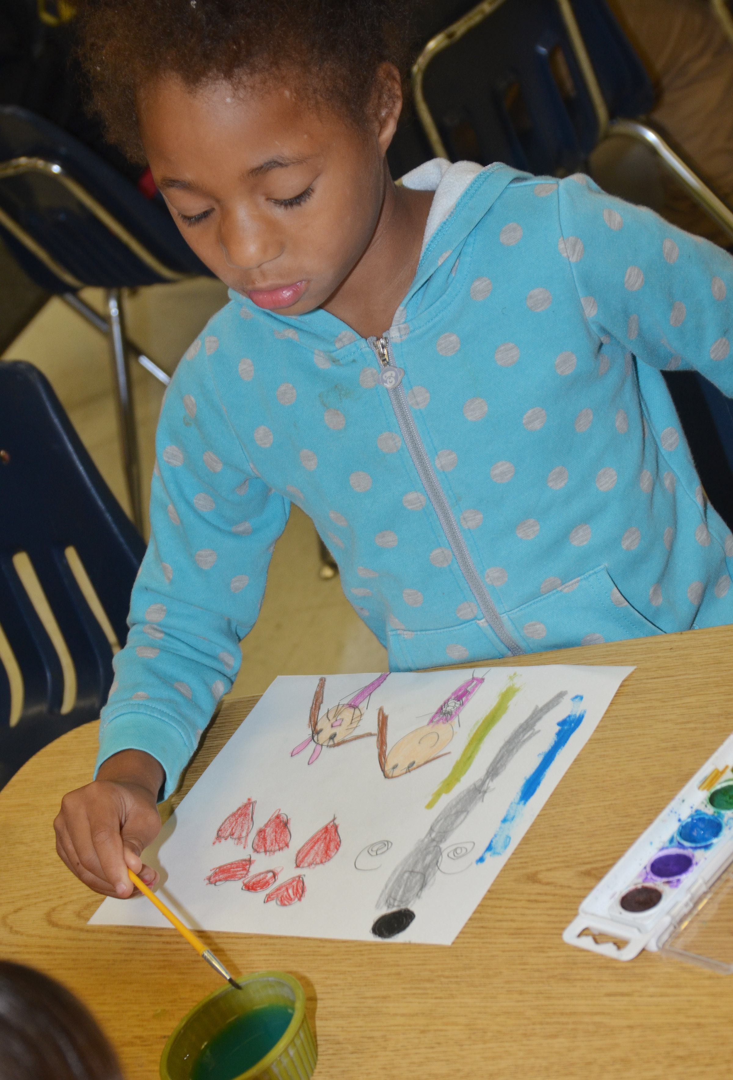 CES first-graders Brea Miller paints.