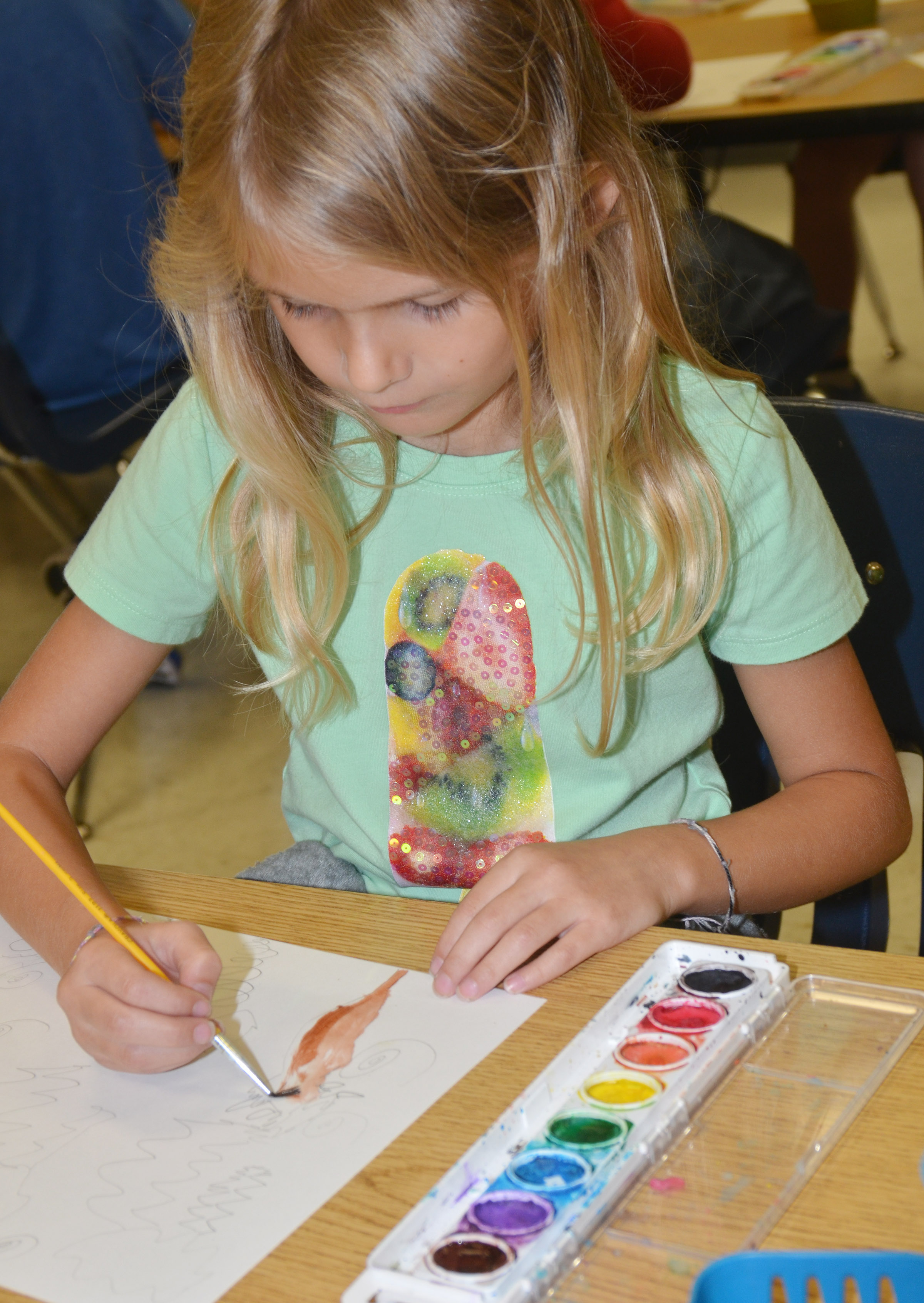 CES first-grader Gracie Gebler paints.
