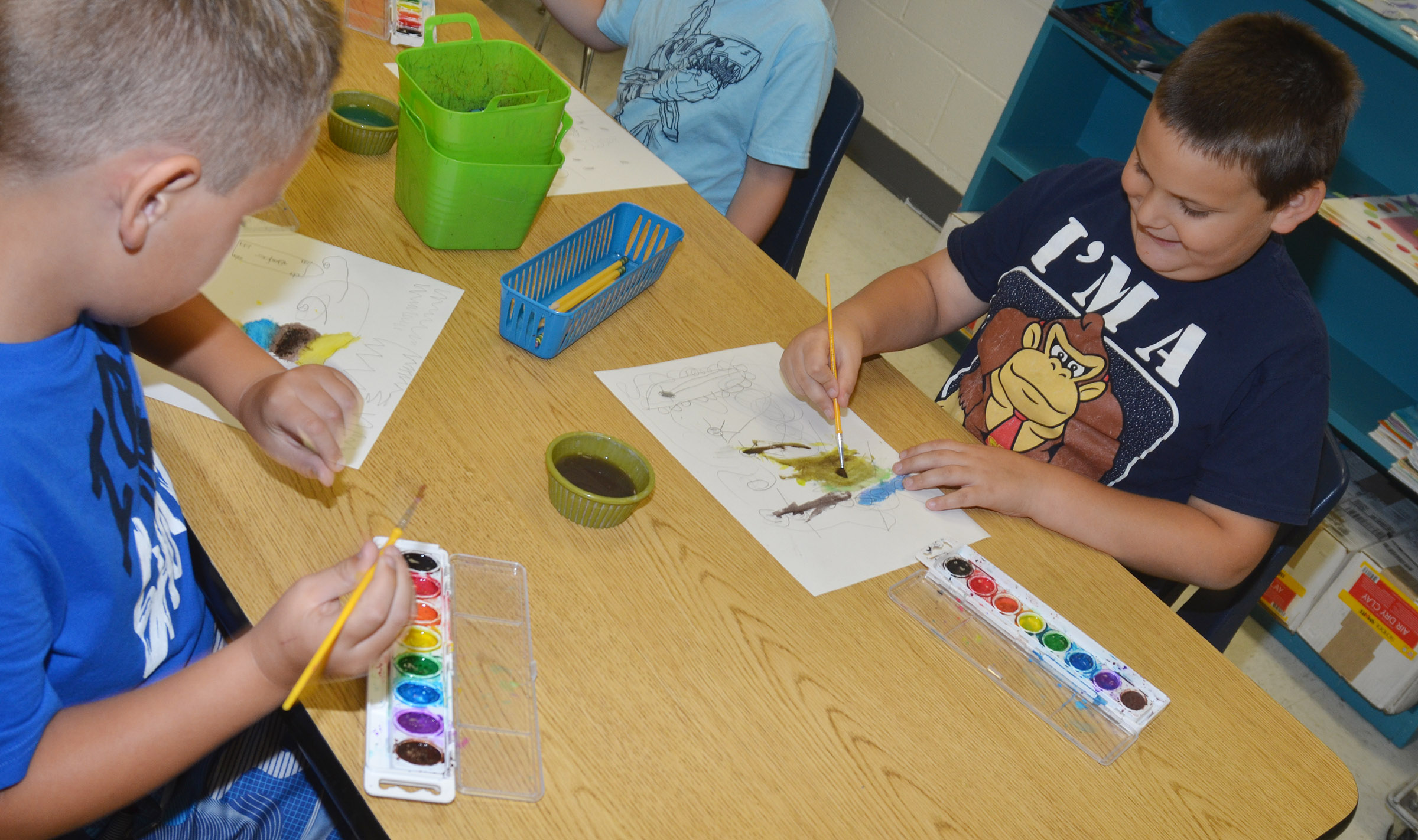 CES first-grader Cloud Malone paints with his classmates.