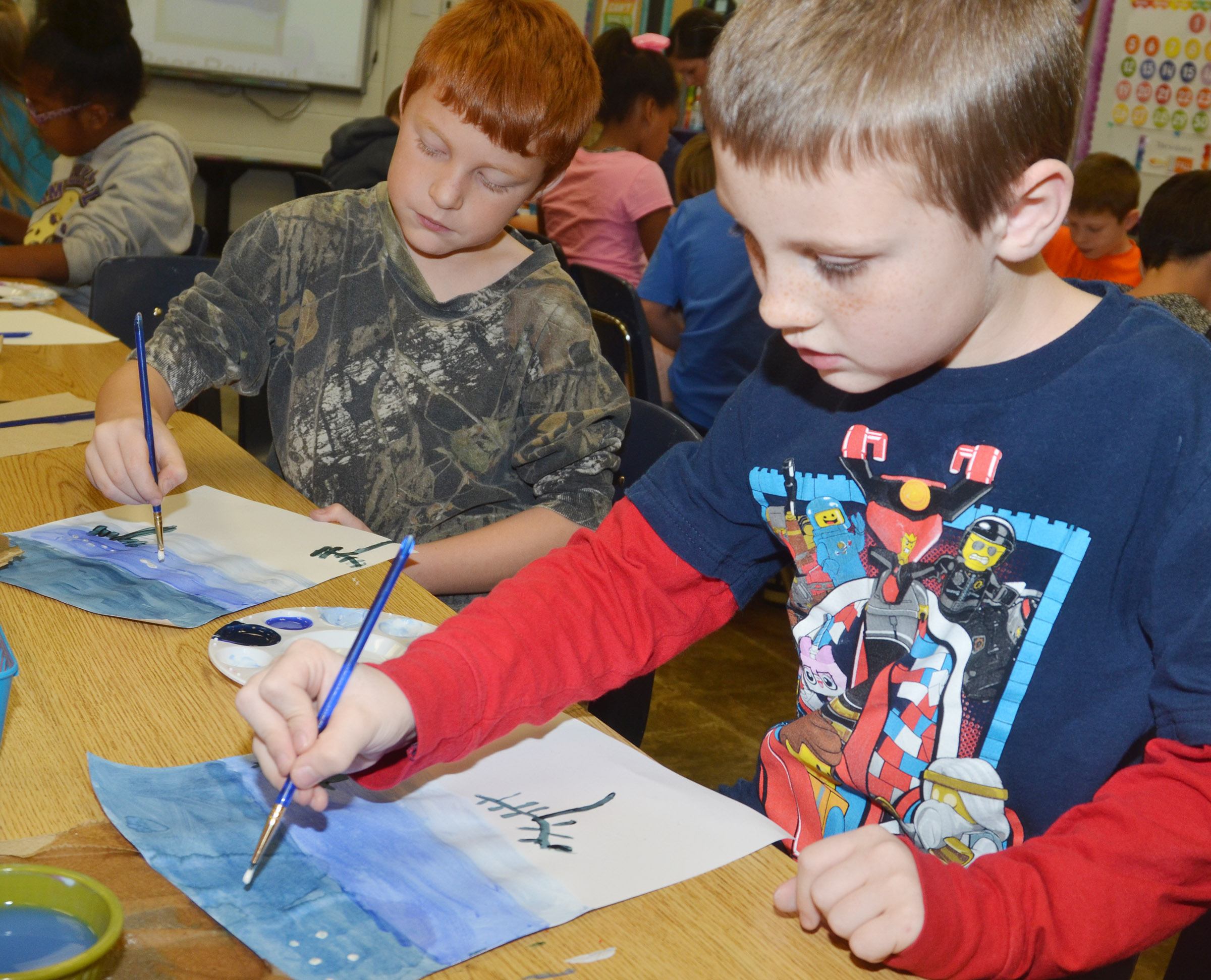 CES second-graders Carter Wethington, at left, and James Brunner paint.