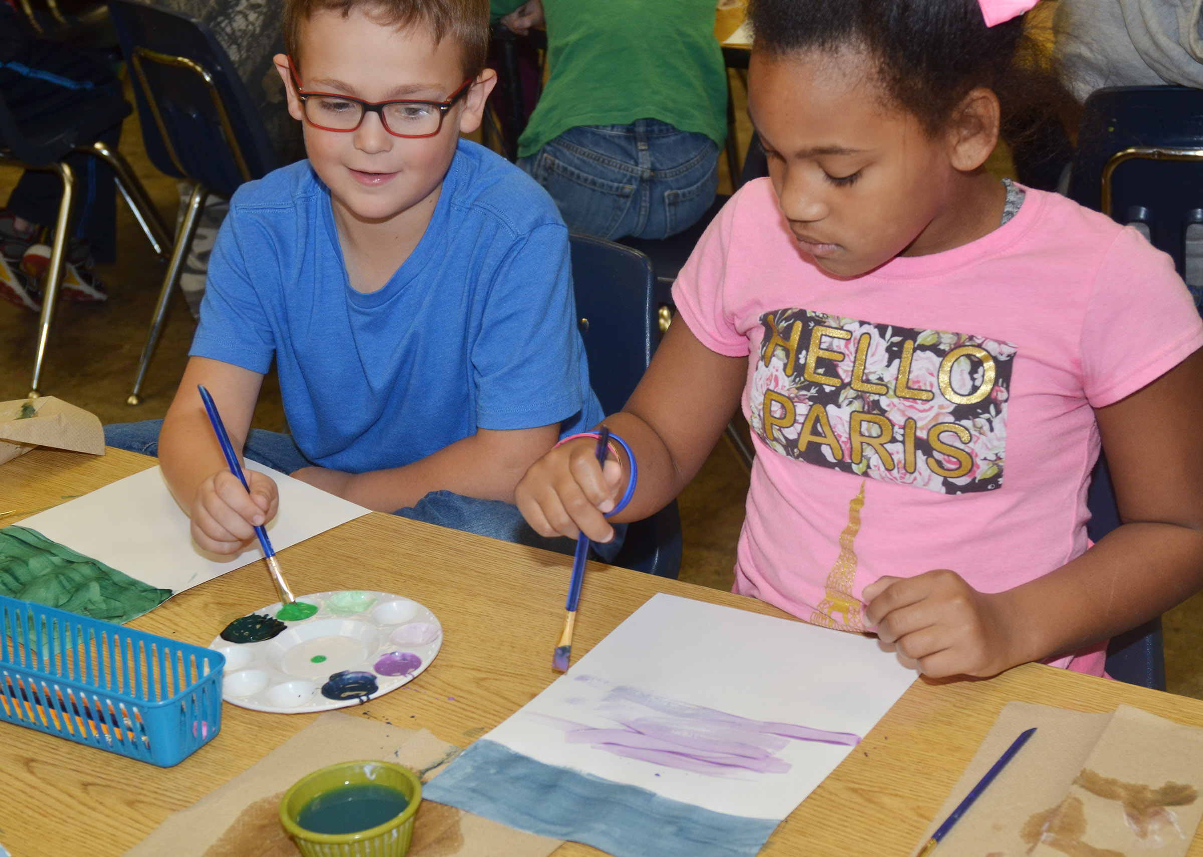 CES second-graders Brendan Martin, at left, and Ally Dunn paint.