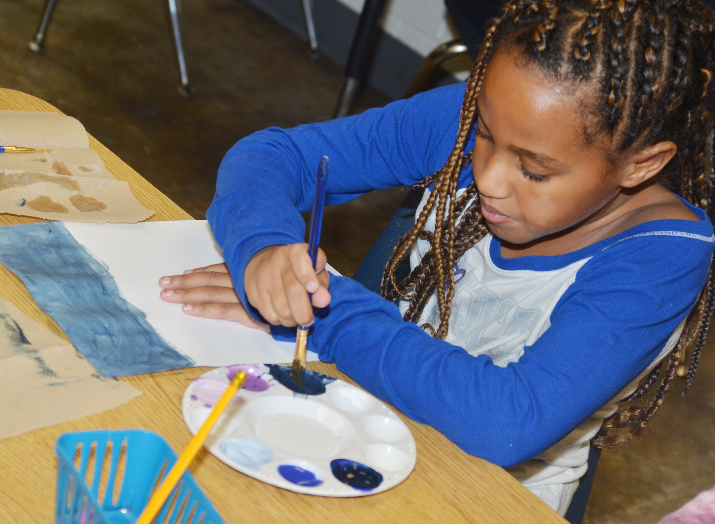 CES second-grader Kadance Ford paints her sky.