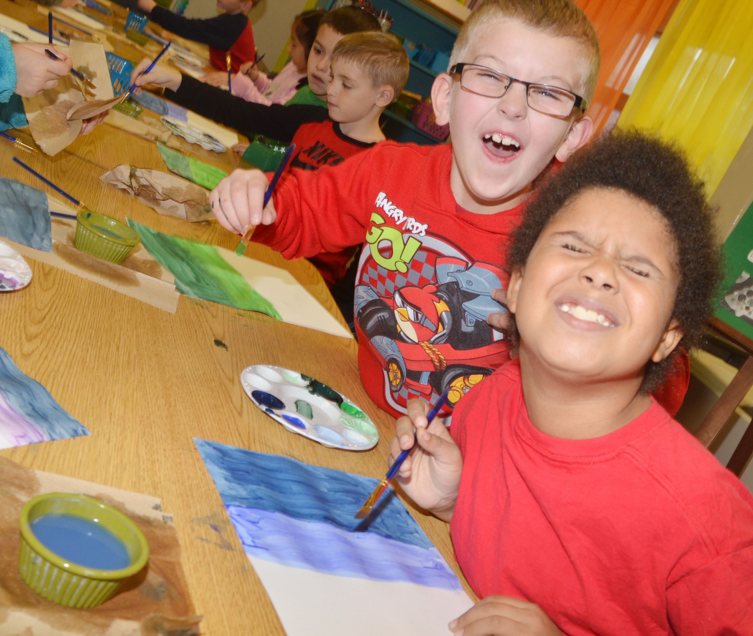 CES second-graders Ethan Bailey, at left, and Navon Copeland have fun as they paint.