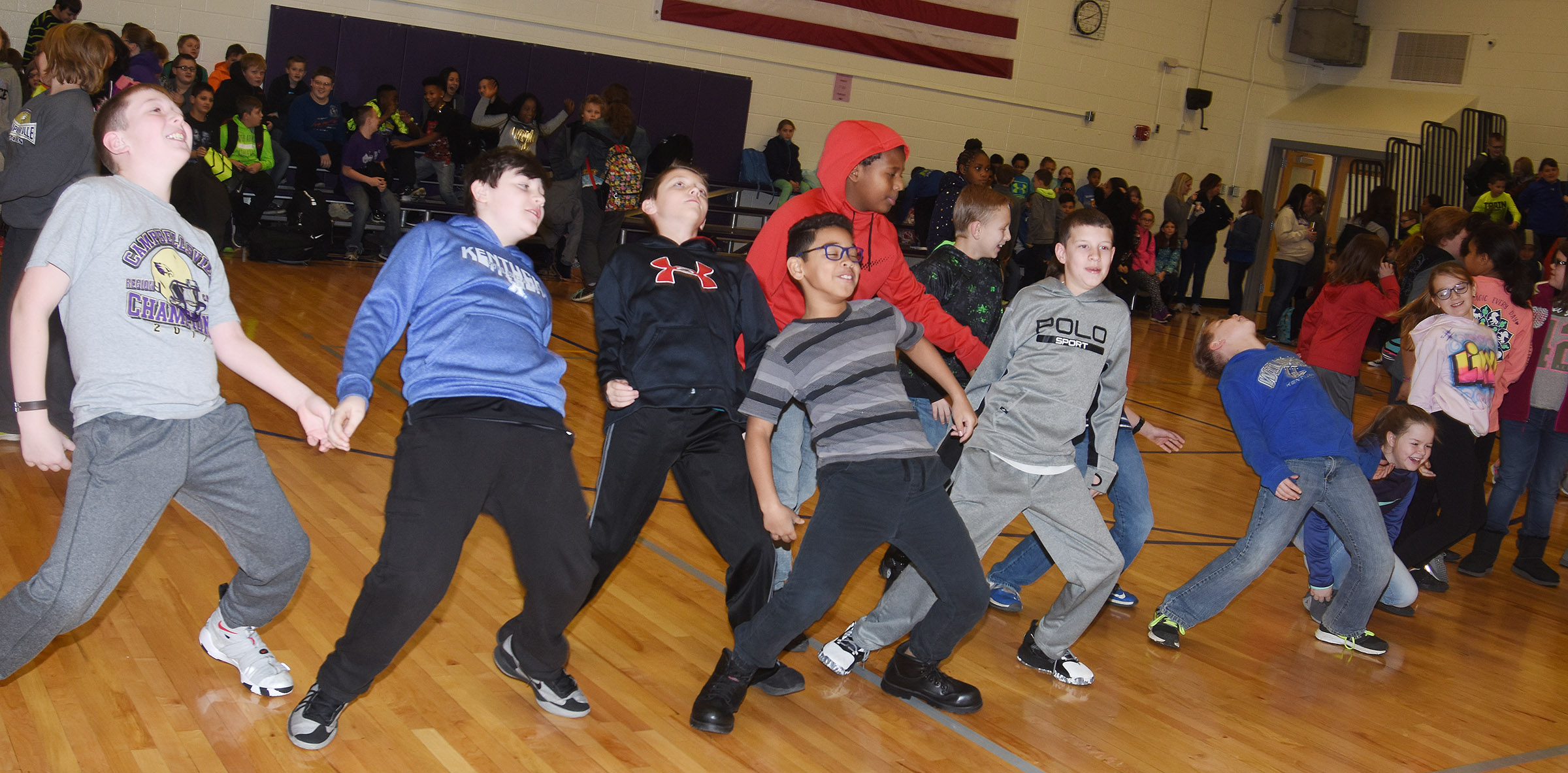 CES fifth-graders dance after the first school assembly of 2018.