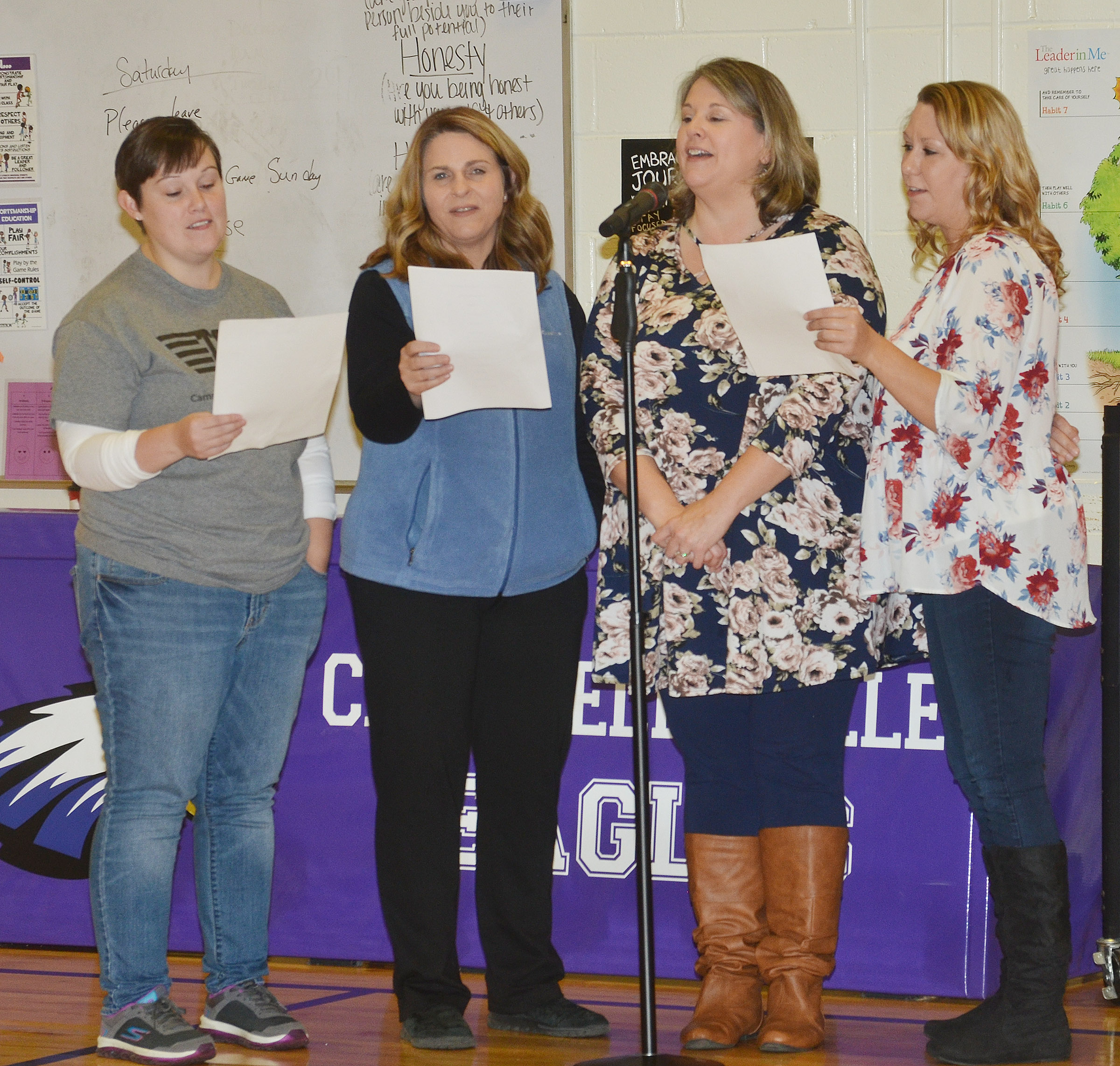"From left, CES teacher Amanda Barnett, Guidance Counselor Sonya Orberson and teachers Cyndi Chadwick and Amanda Greer sing ""The Twelve Days of Christmas."""