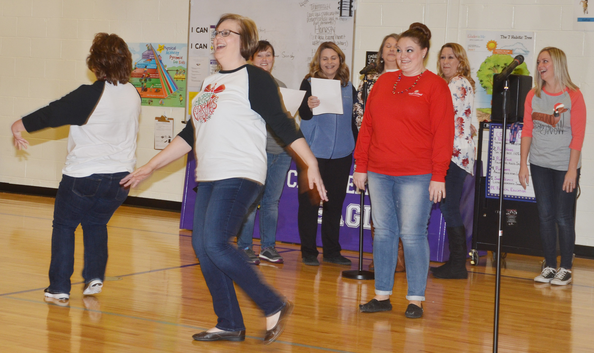 "CES teachers Tracey Rinehart, at left, and Tonya Hagan dance as they sing ""The Twelve Days of Christmas."""