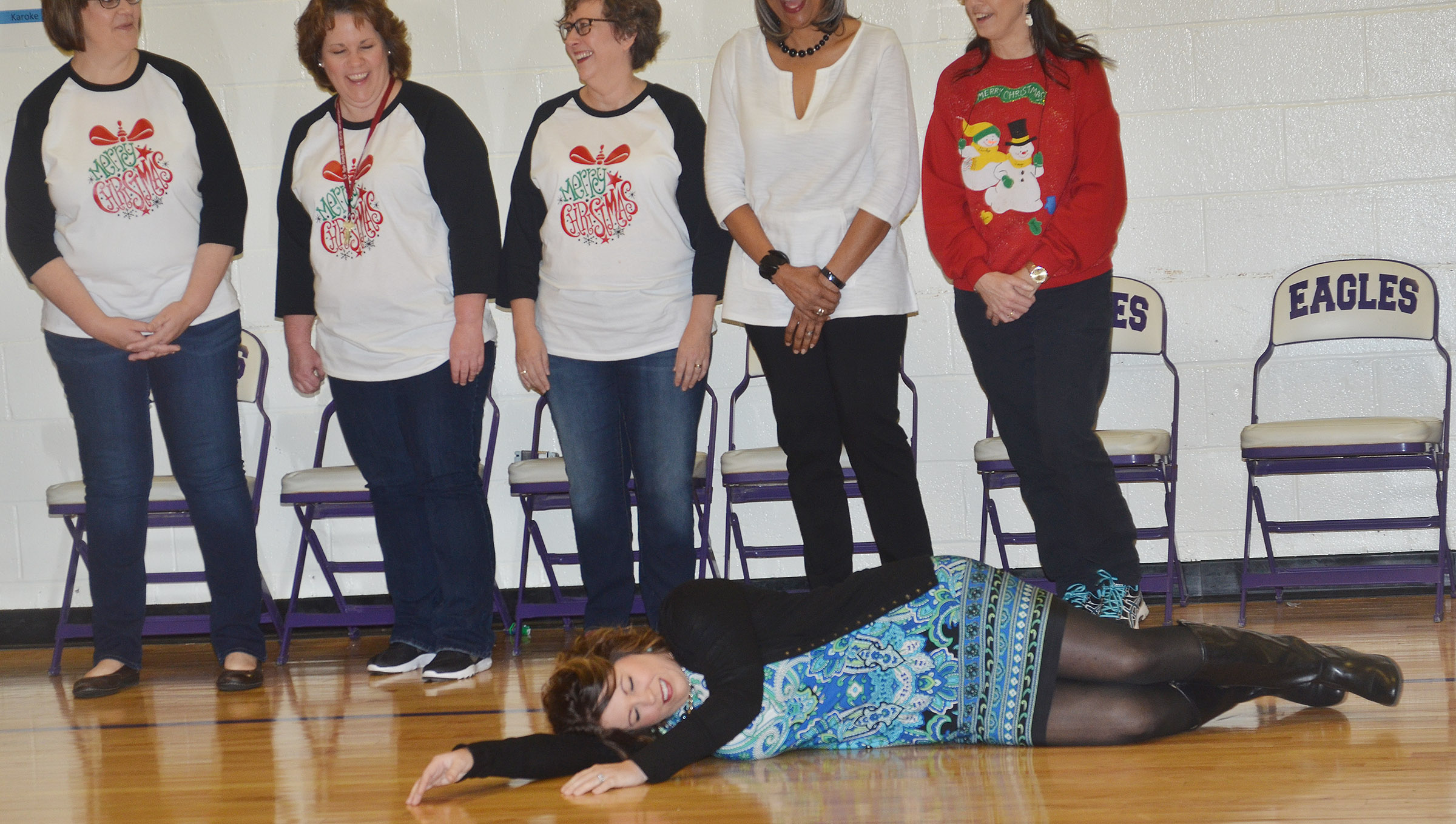 "CES Principal Elisha Rhodes performs as she and her fellow teachers sing ""The Twelve Days of Christmas."""