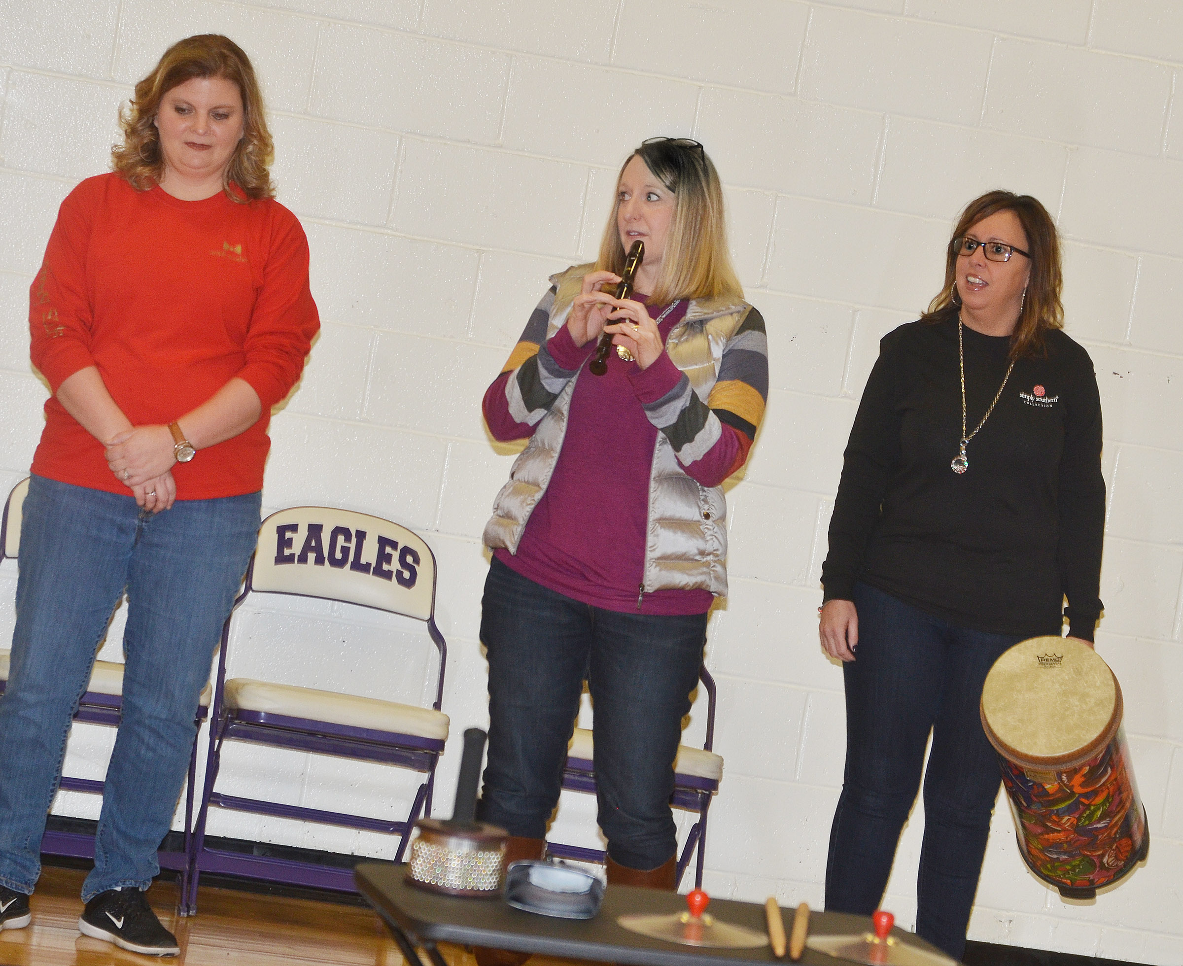 "CES teachers, from left, Tammy Hash, Laura Dicken and Farrah Hord perform ""The Twelve Days of Christmas."""