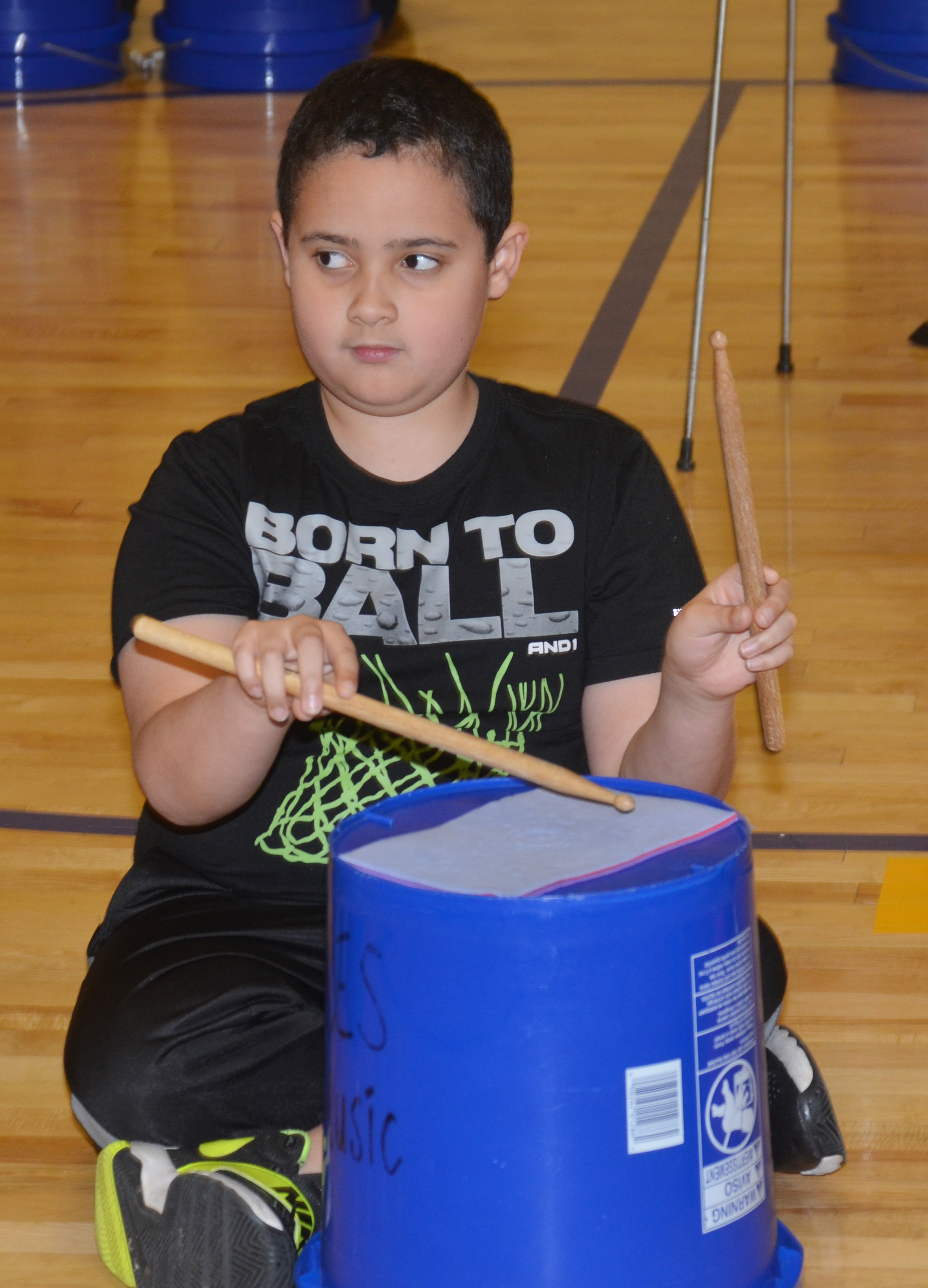 CES fourth-grader Tayshaun Hickman plays the bucket drums.