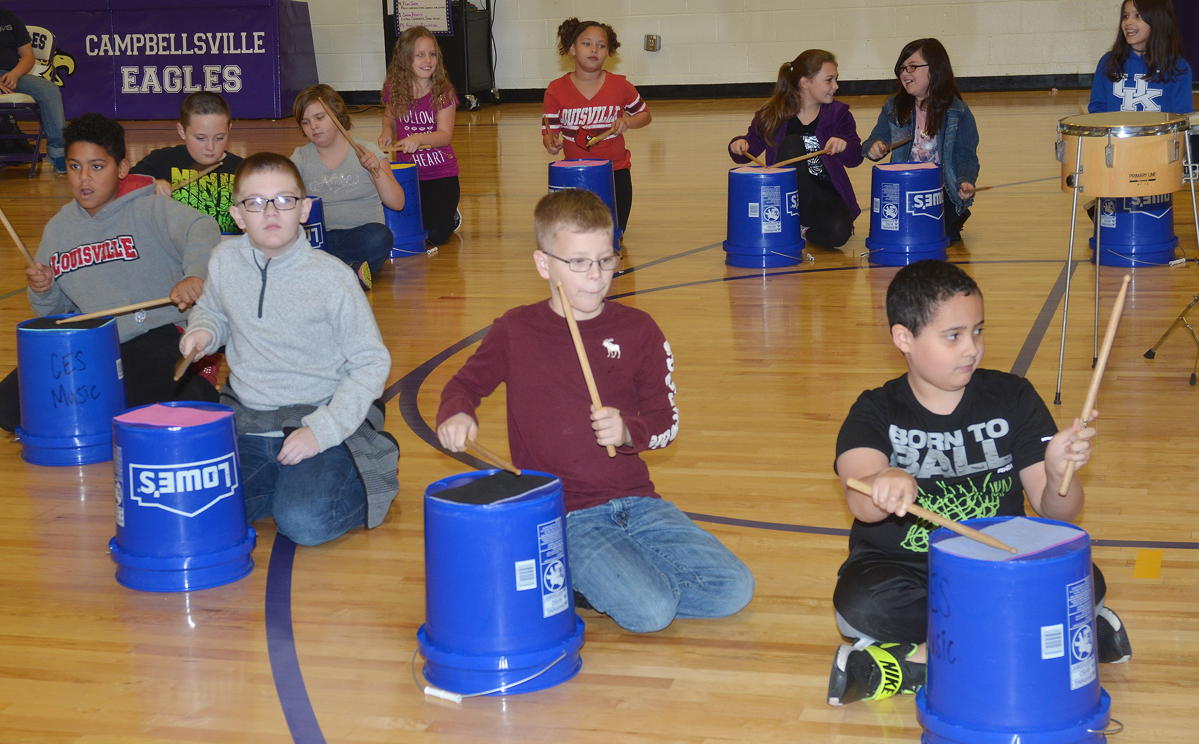 CES fourth-graders play the bucket drums.