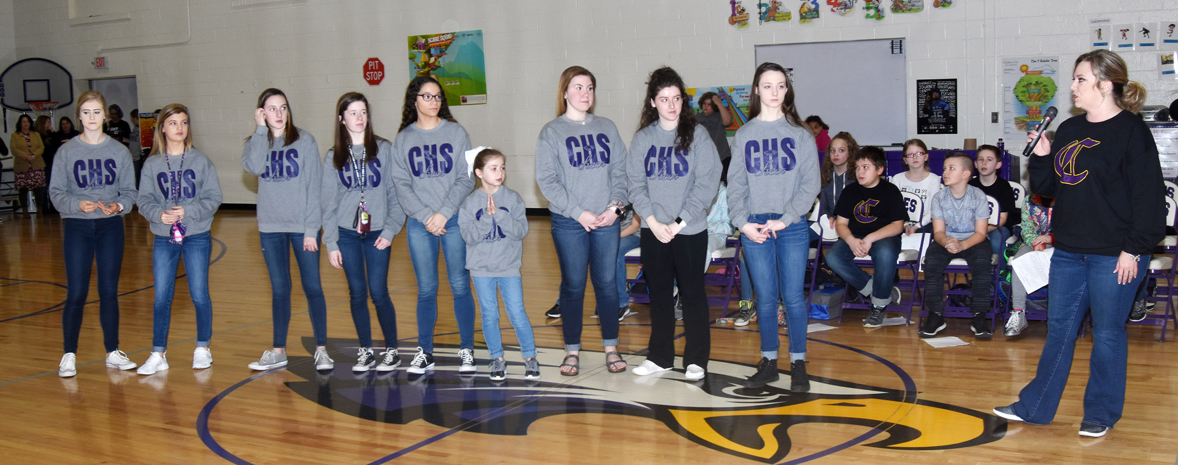 CHS cheerleading co-sponsor Nikki Price, at right, recognizes the CHS cheerleaders at the CES assembly on Friday, March 2.