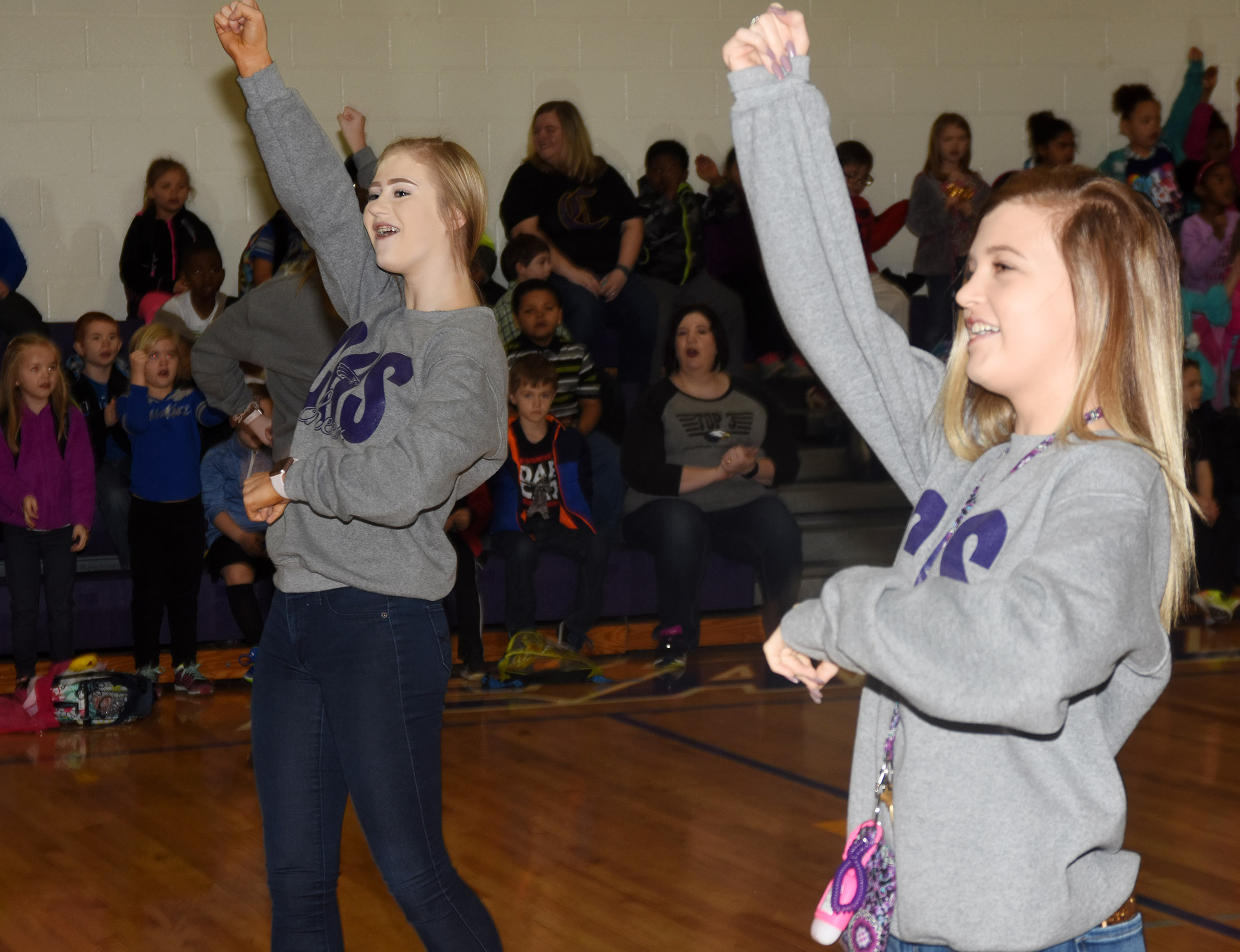 CHS sophomore Isabella Osborne, at left, and freshman Carly Adams lead CES students in a cheer.