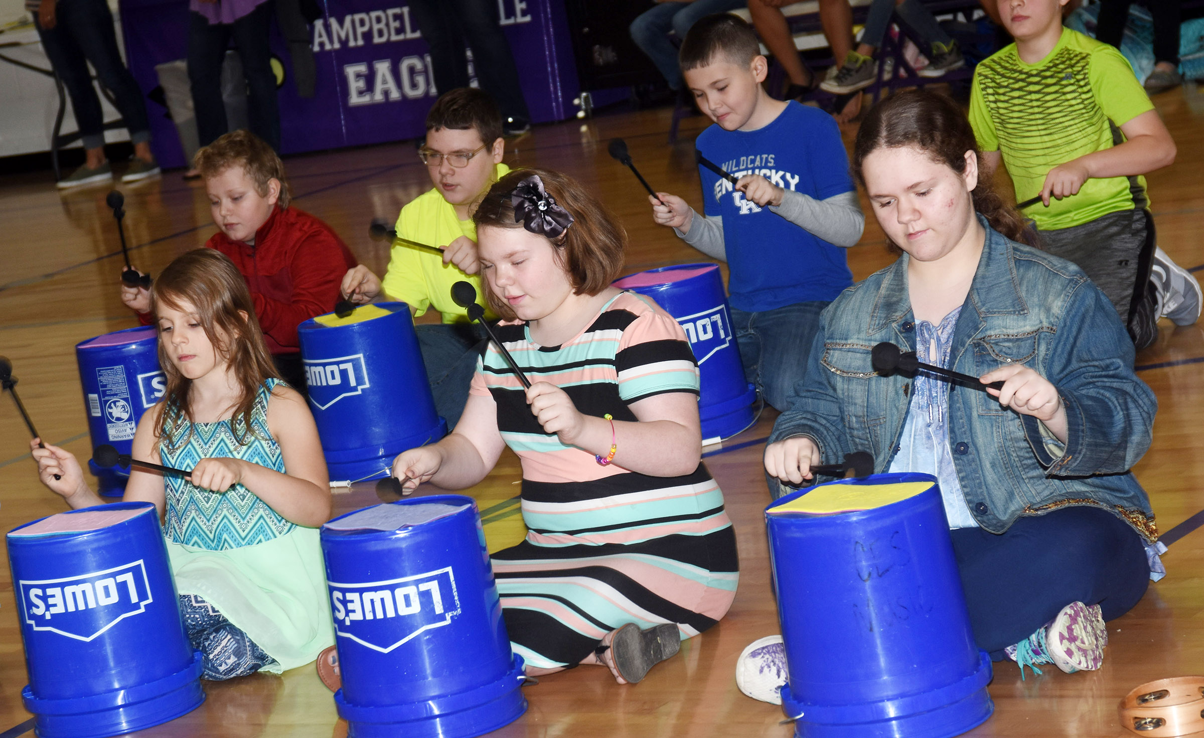 CES fifth-graders play the bucket drums. From left, front, are Ellie Wise, Averi Perkins and Chloe Hoppes. Back, J.P. Gutierrez, Ian Creason and Michael Abel.