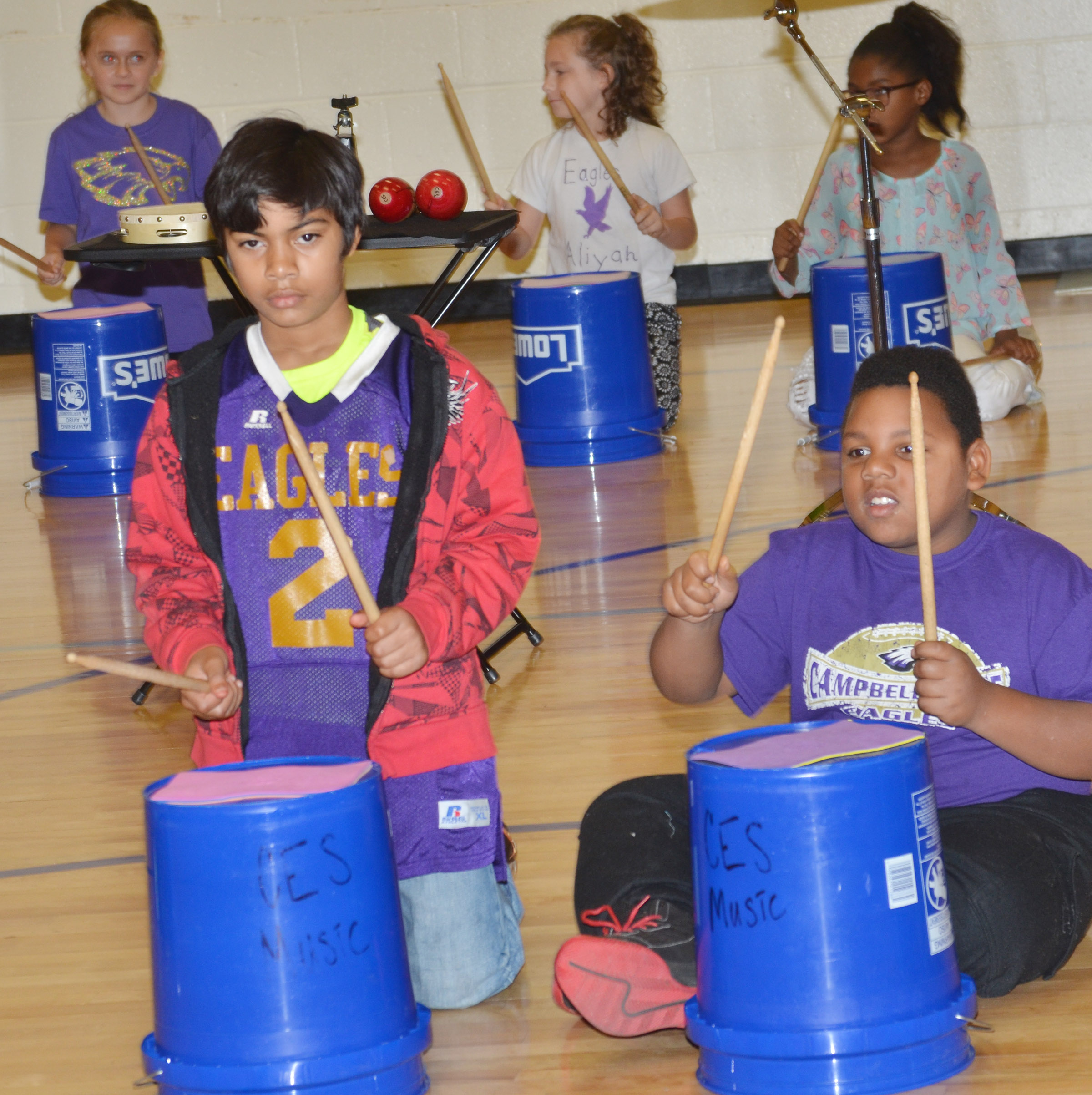 CES fourth-graders LaDainien Smith, at left, and Malikiah Spurling play the bucket drums.