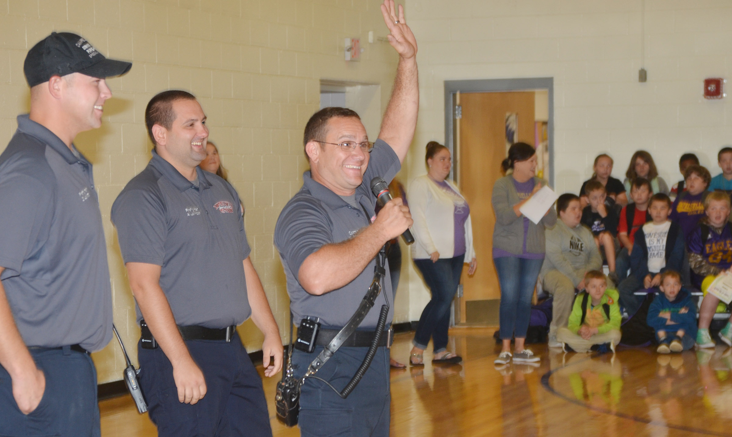 Campbellsville Fire & Rescue Captain Keith Bricken greets CES students. At left are firefighters Daniel Lovett, at left, and Alex Johnson.