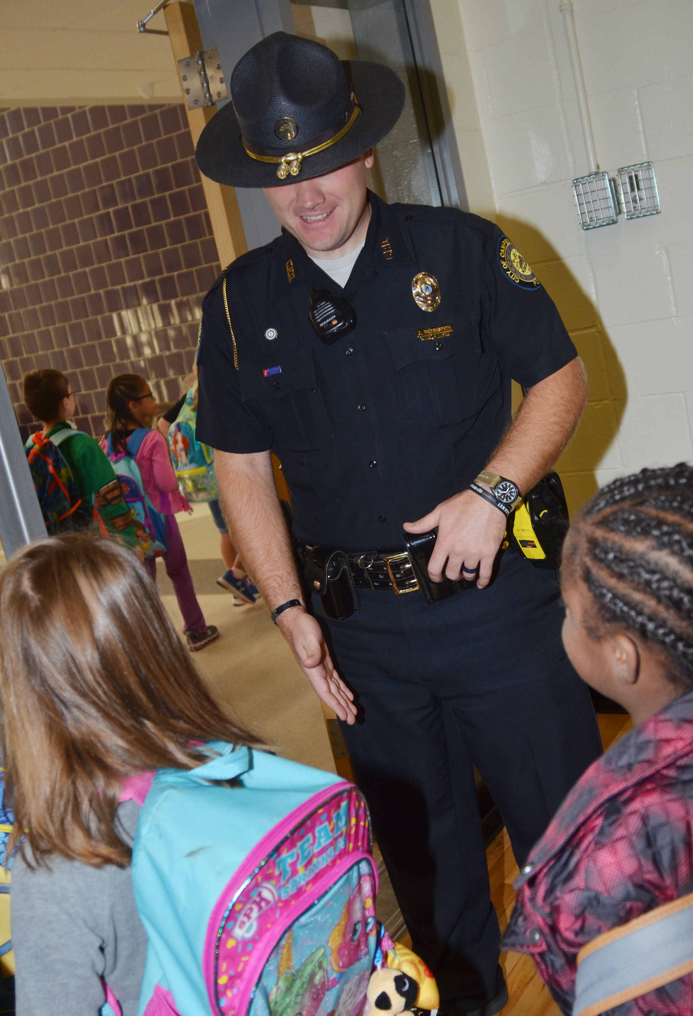 Campbellsville Police Officer Jake Hedgespeth greets CES students as they walk to their classrooms.