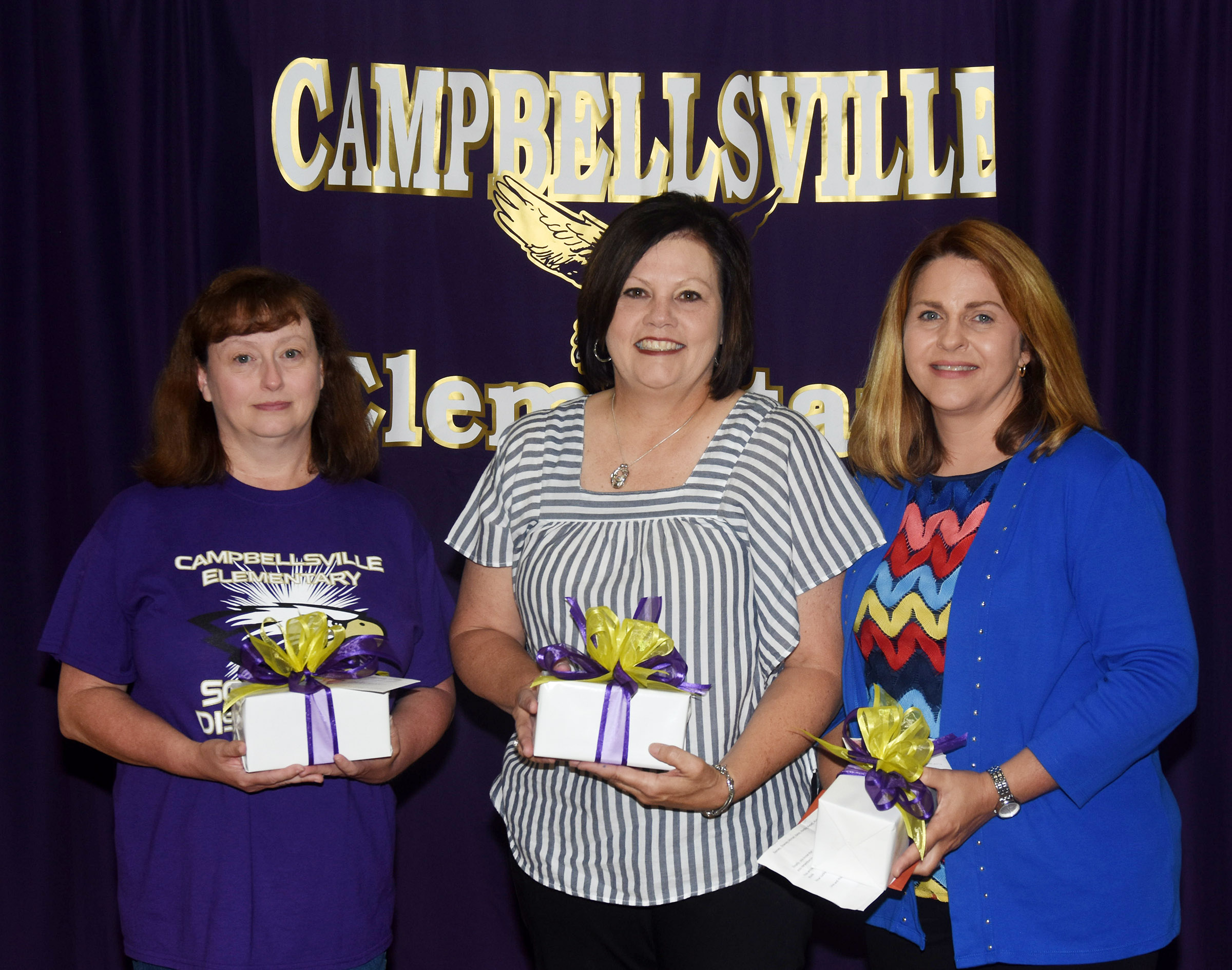 CES students and staff members honored three employees at the assembly on Friday, May 18, who will retire at the end of the school year. From left are kindergarten assistant Carolyn Osborne, second-grade teacher Lisa Kearney and counselor Sonya Orberson.