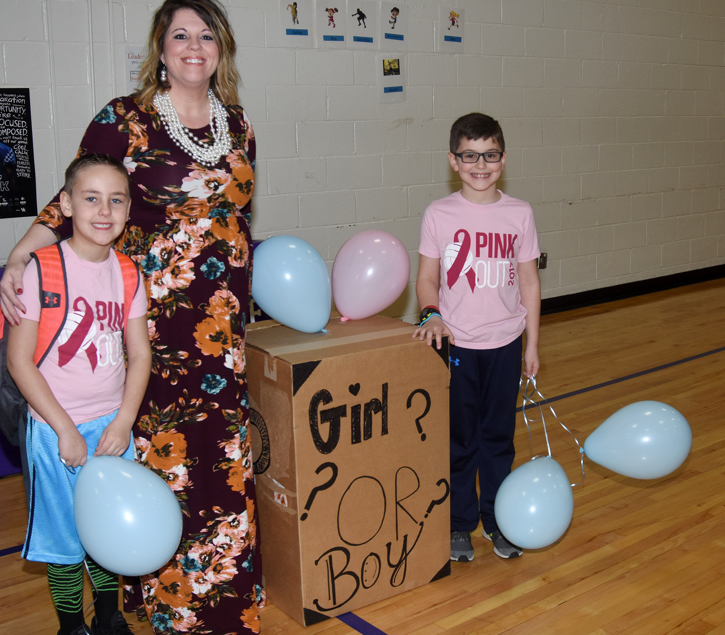 CES Principal Elisha Rhodes had some help revealing the gender of her baby, due in August. Rhodes is expecting her third boy. She is pictured with her sons Braxton, at left, a first-grader, and Tye, a third-grader.