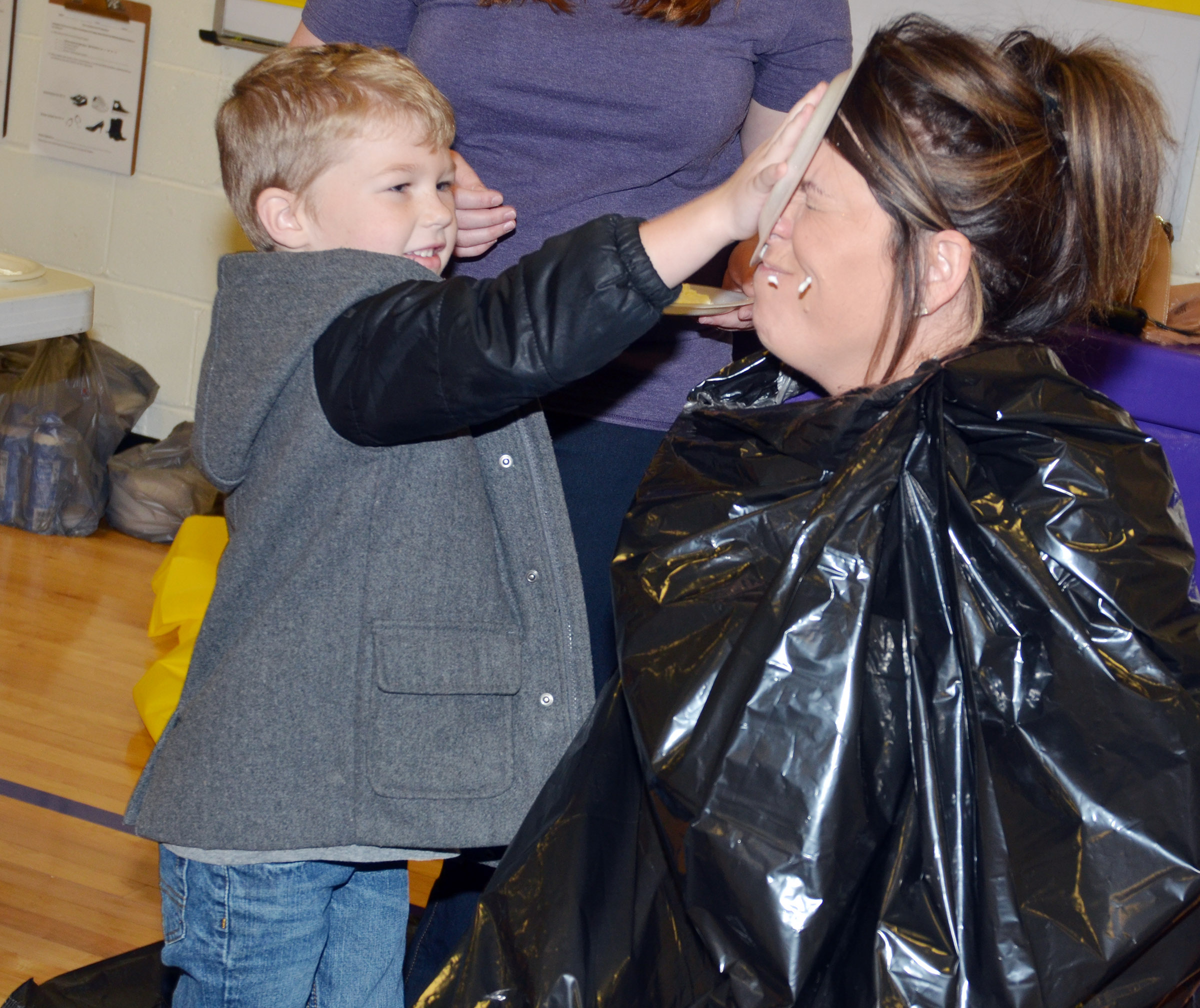 CES kindergartener Landry Brown is the first to pie Principal Elisha Rhodes in the face.