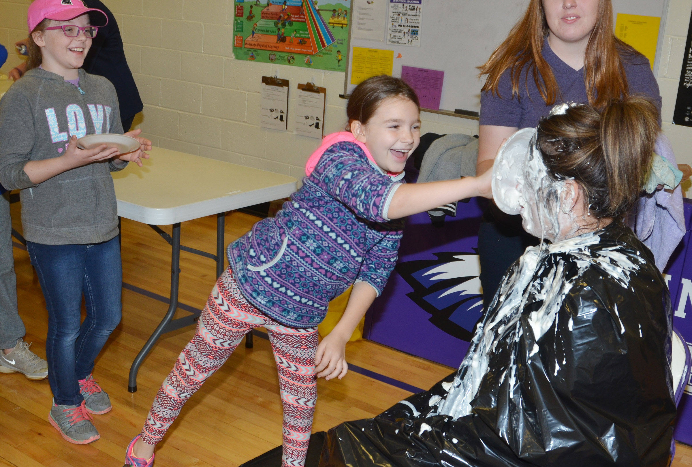 CES fourth-grader Destiny Abell pies Principal Elisha Rhodes in the face.
