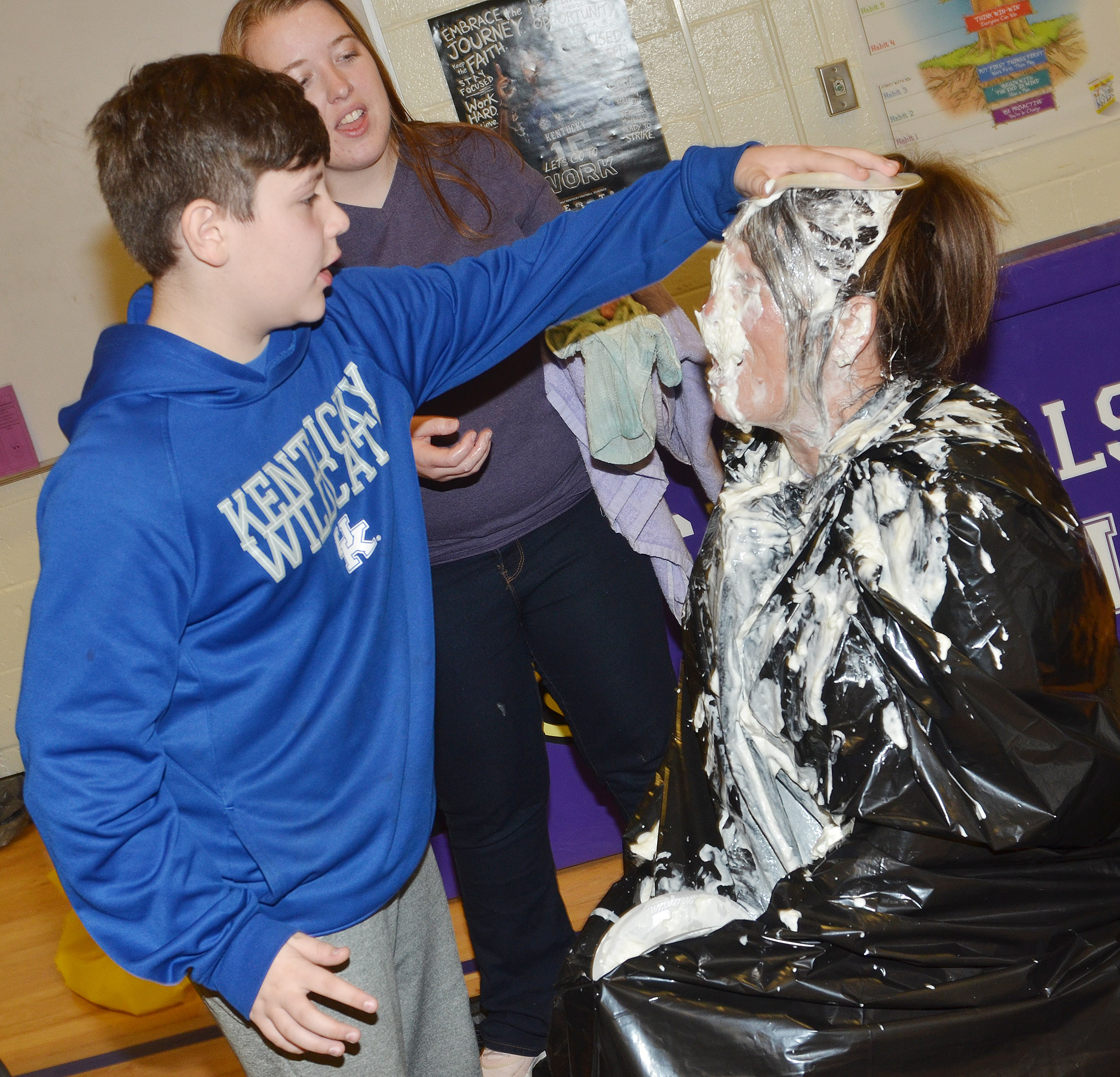 CES fifth-grader Andrew Mardis pies Principal Elisha Rhodes in the face.