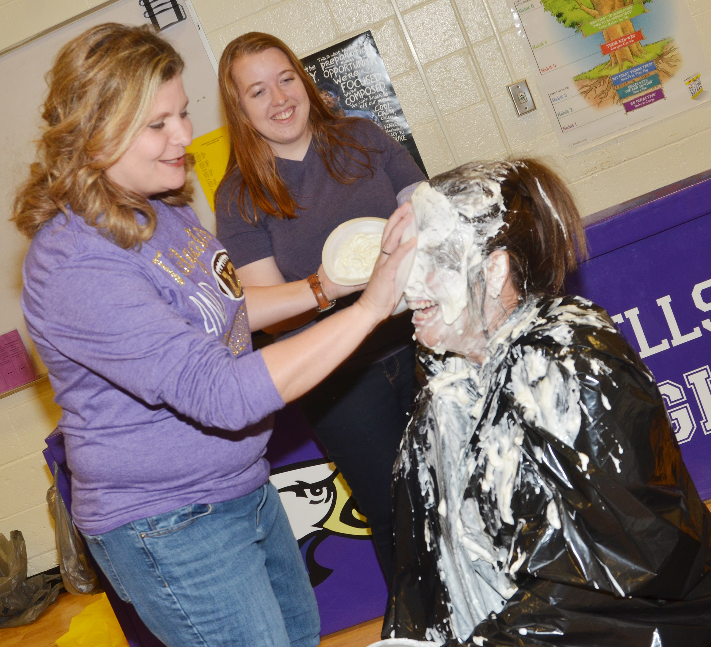 CES fifth-grade teacher Tammy Hash pies Principal Elisha Rhodes in the face.
