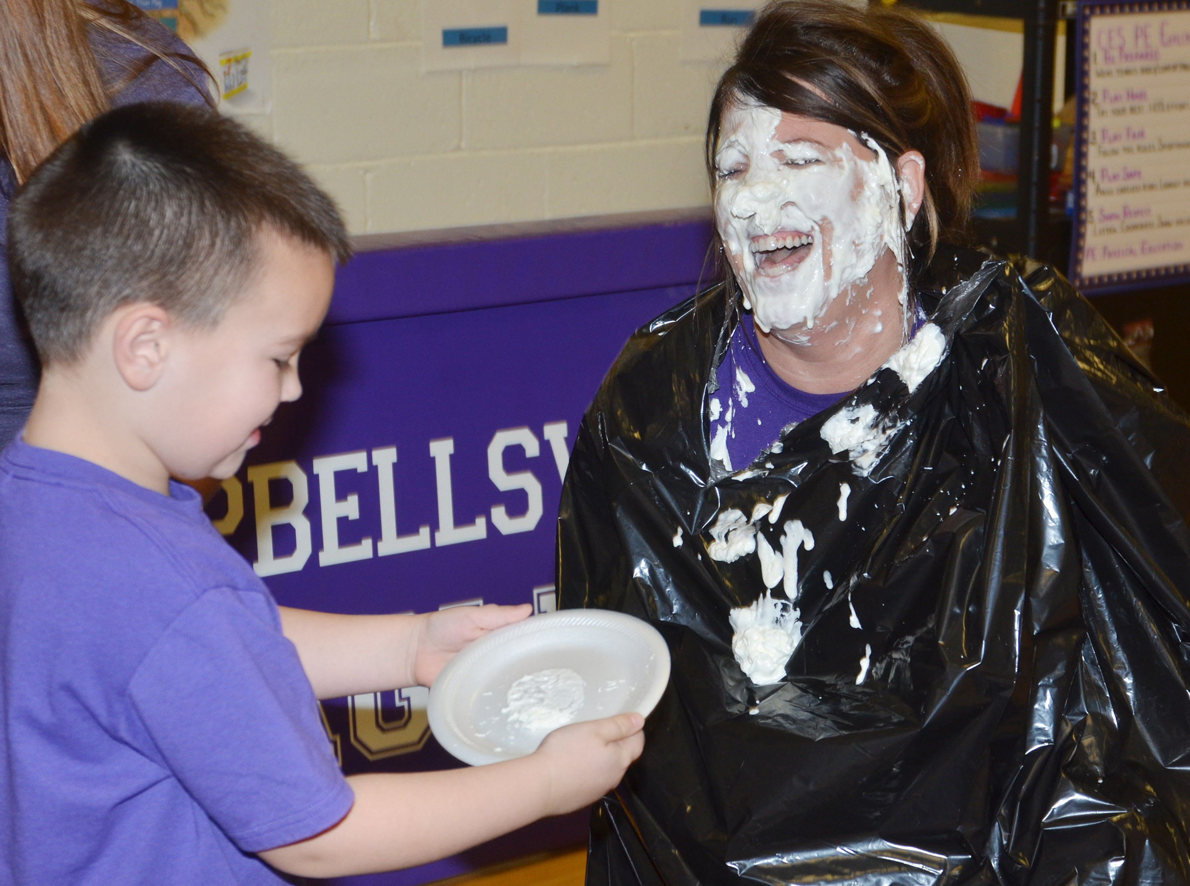 CES Principal Elisha Rhodes laughs after kindergartener Xander Britton pies her in the face.