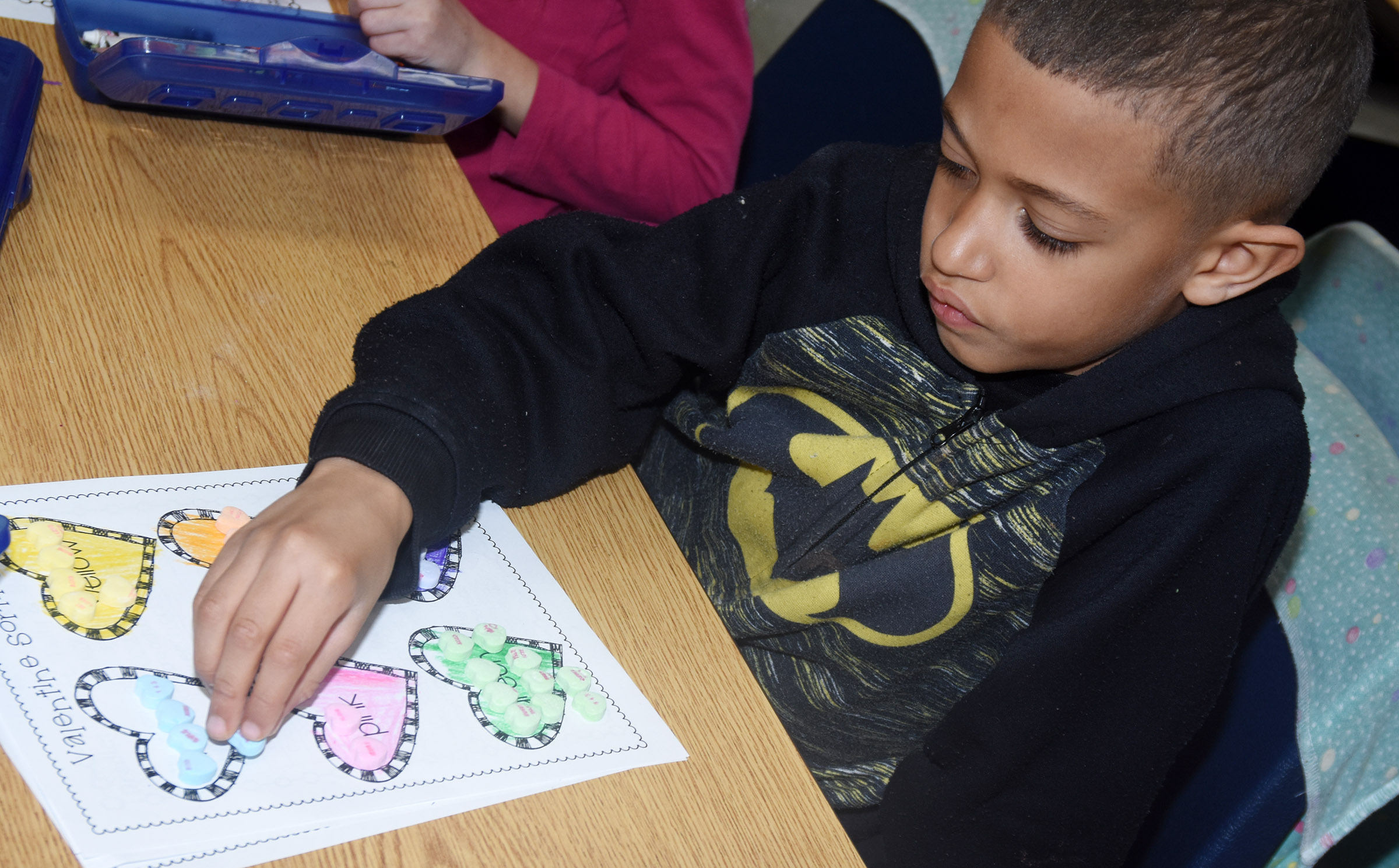 CES first-grader Tyce Owens sorts his hearts.