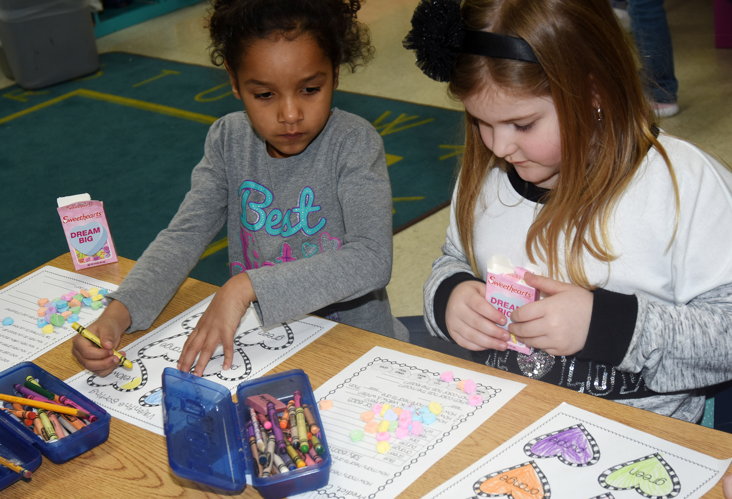 CES first-graders Kylei Thompson, at left, and Aubreigh Knifley sort their hearts.