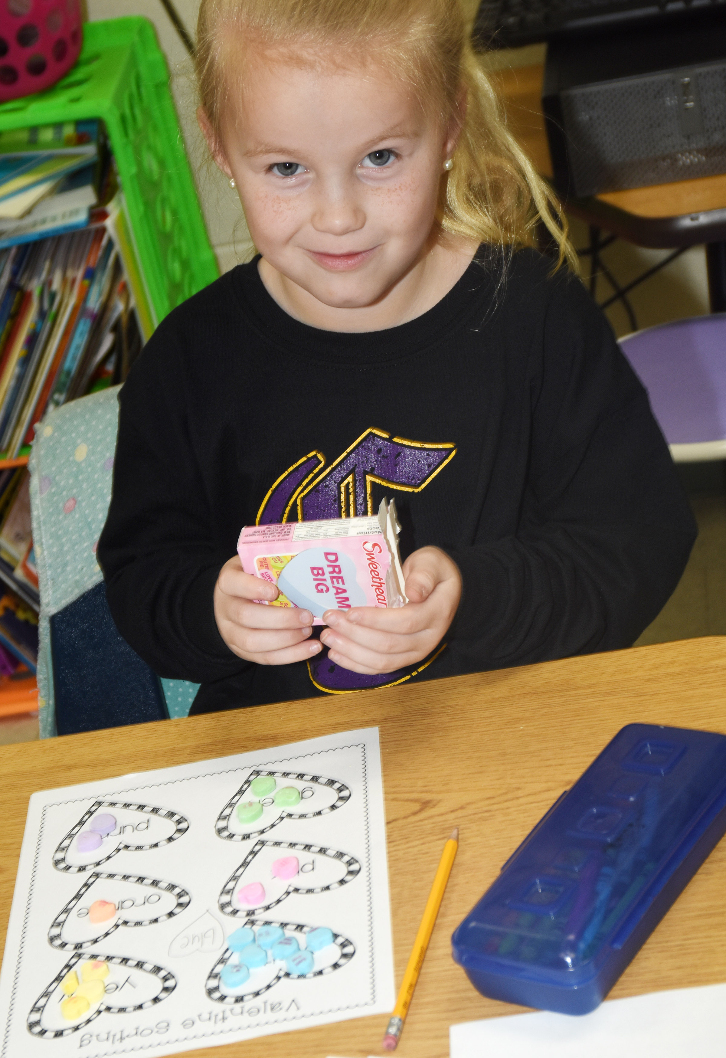 CES first-grader Lillie Judd sorts her hearts.