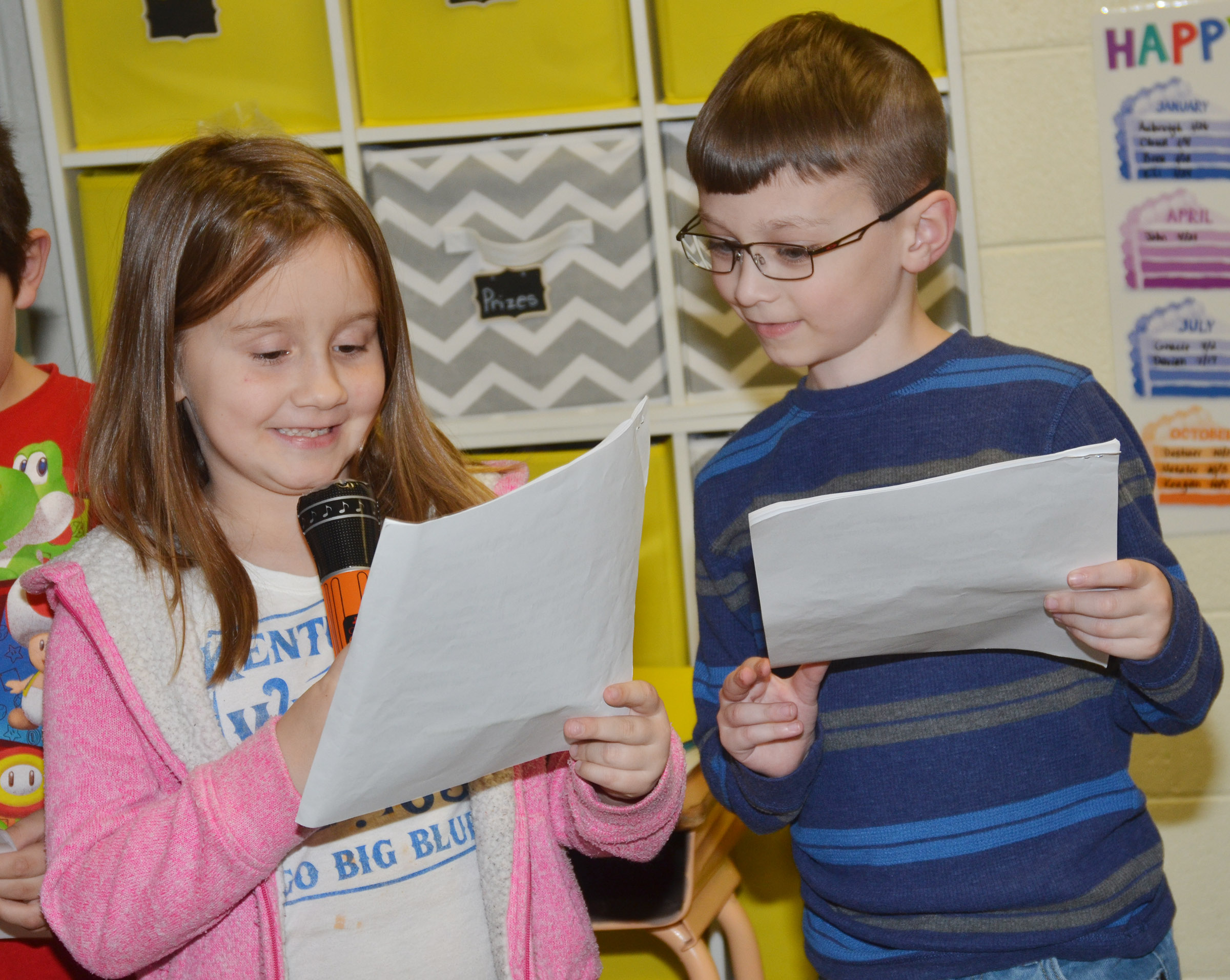 CES first-graders Natalee Shaw, at left, and Parker Newton practice their lines.