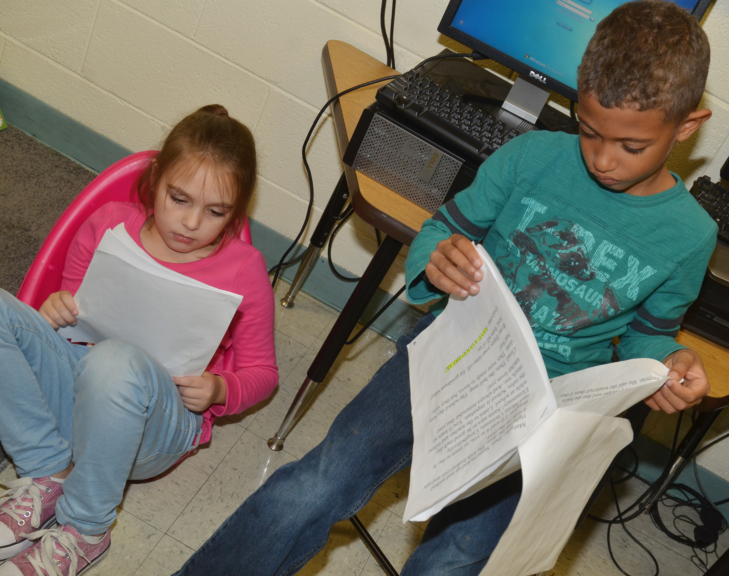 CES first-graders Aubrey Allen, at left, and Tyce Owens practice their lines.