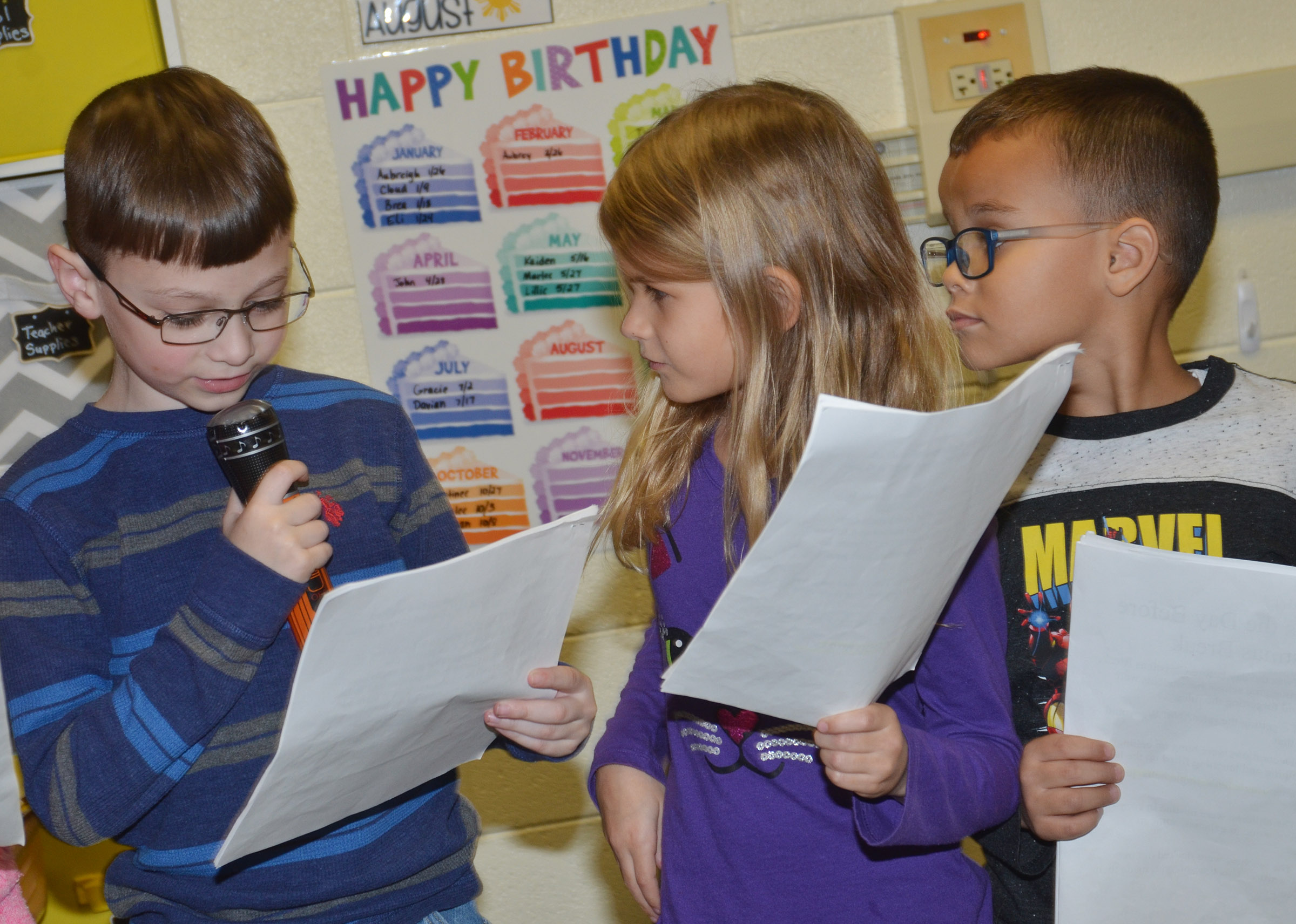 CES first-grader Parker Newton delivers his lines as classmates Gracie Gebler and Davian Taylor wait for their cue.