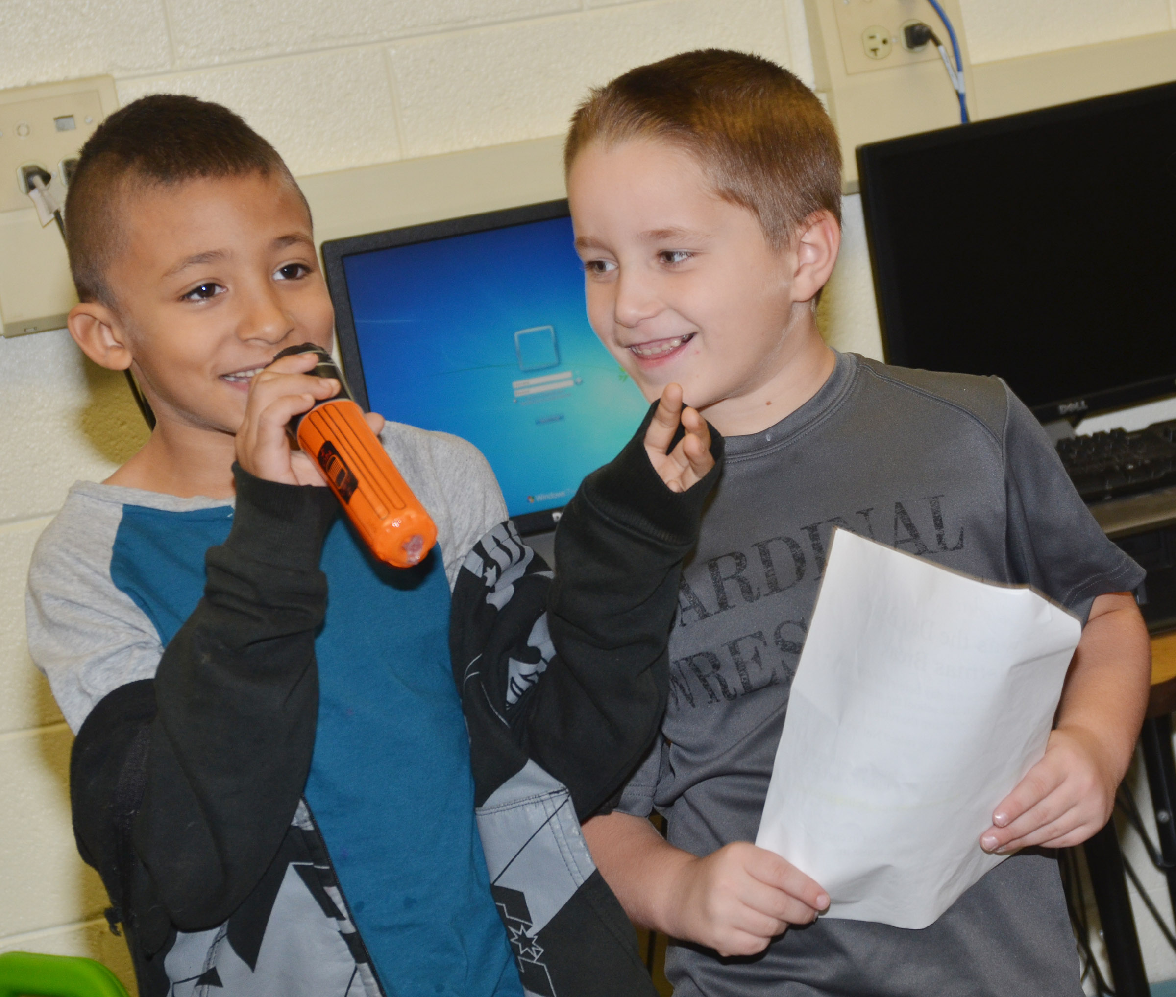 CES first-grader Elijah Williams, at left, delivers his lines as classmate Kaiden Bradfield listens.