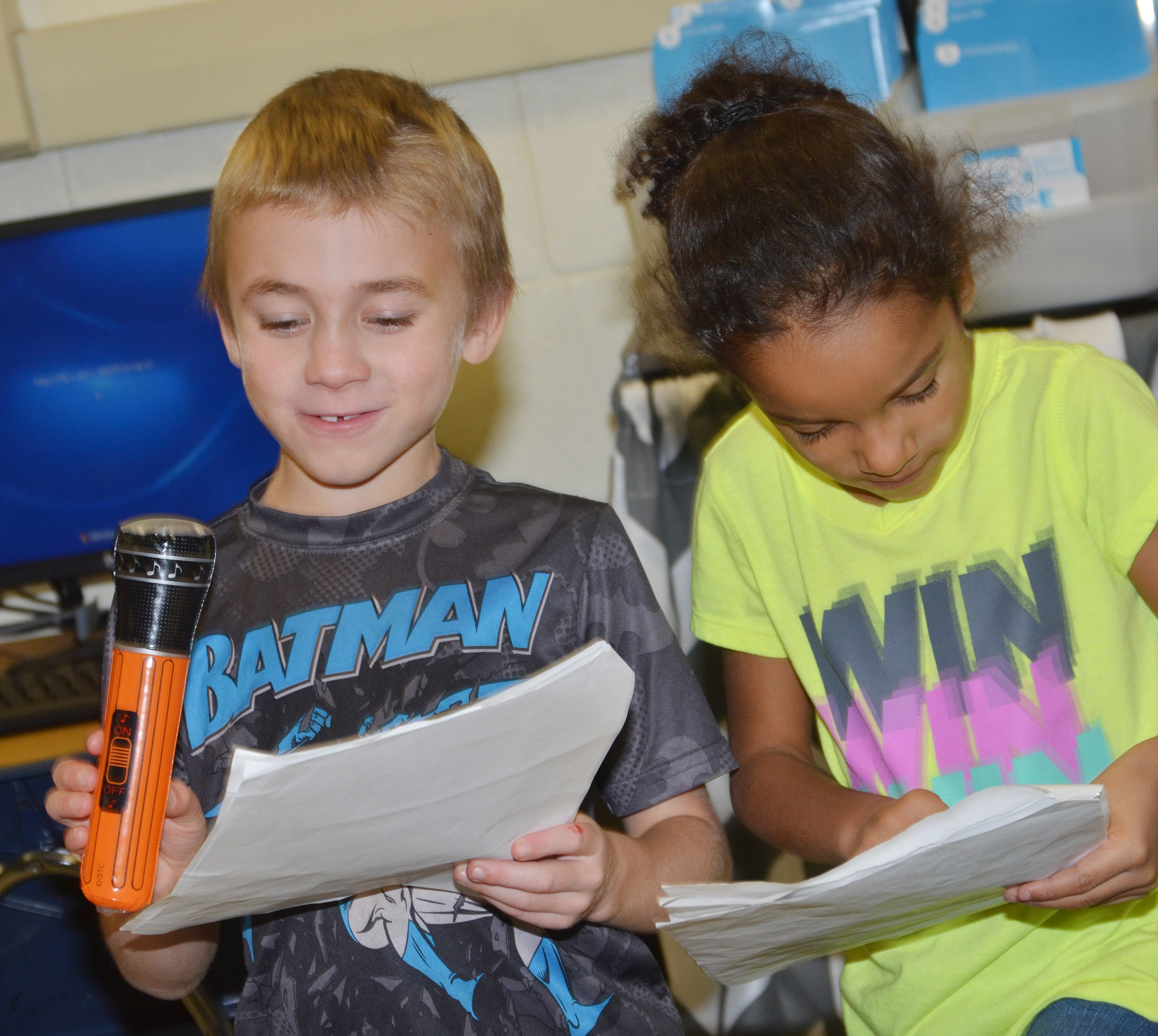 CES first-grader Tyler Bryant reads his lines as classmate Kaylee Thompson reads along.