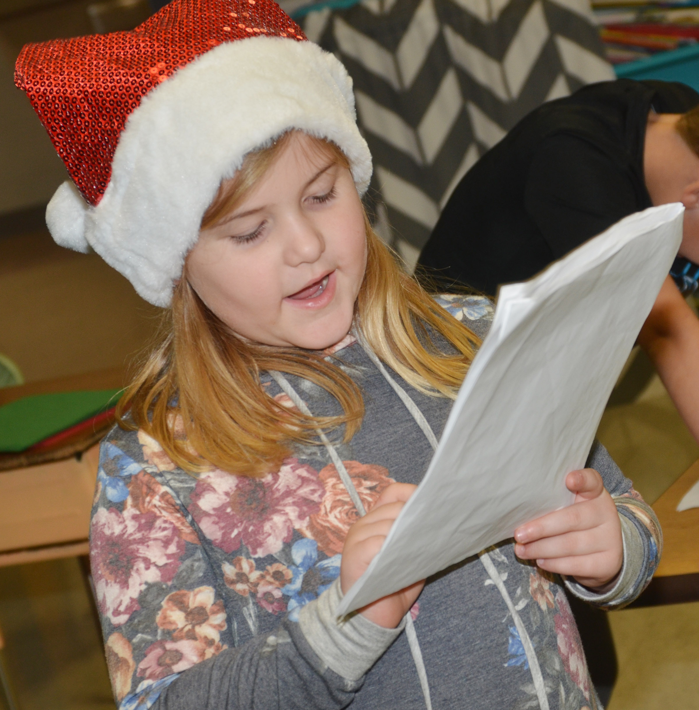 CES first-grader Aubreigh Knifley practices her lines.