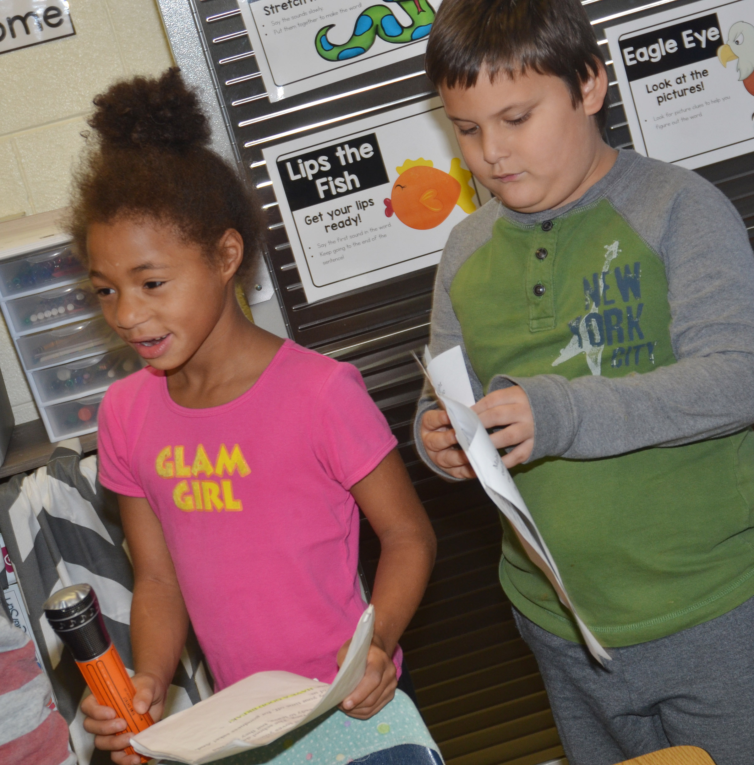 CES first-grader Brea Miller, at left, delivers her lines as classmates Cloud Malone waits for his cue.